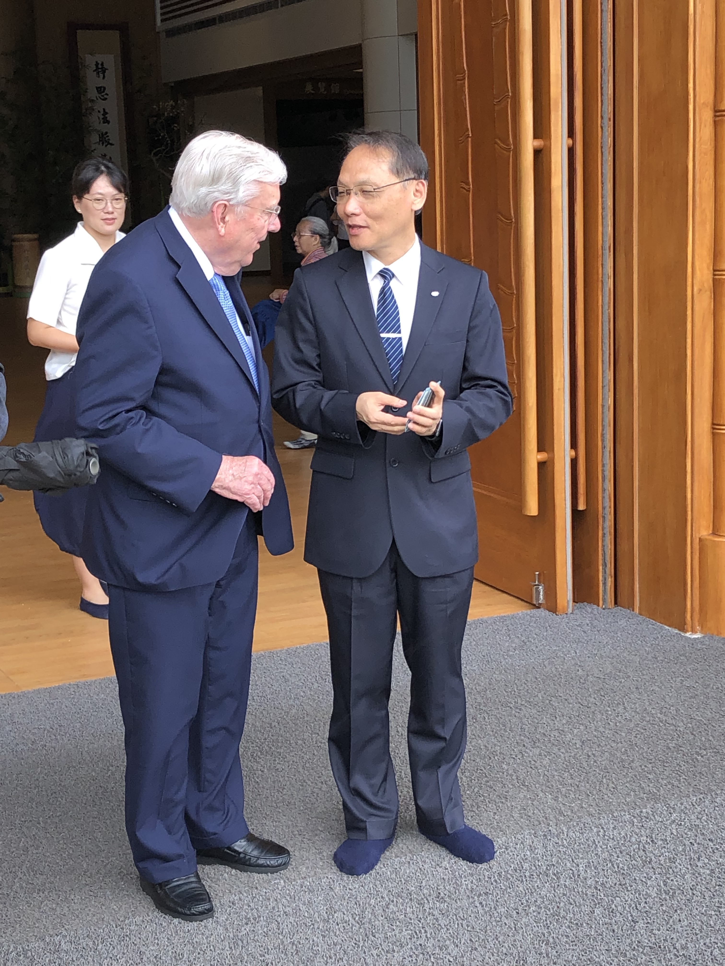 President M. Russell Ballard, left, after a meeting with the Buddhist Compassion Relief in May 2019.