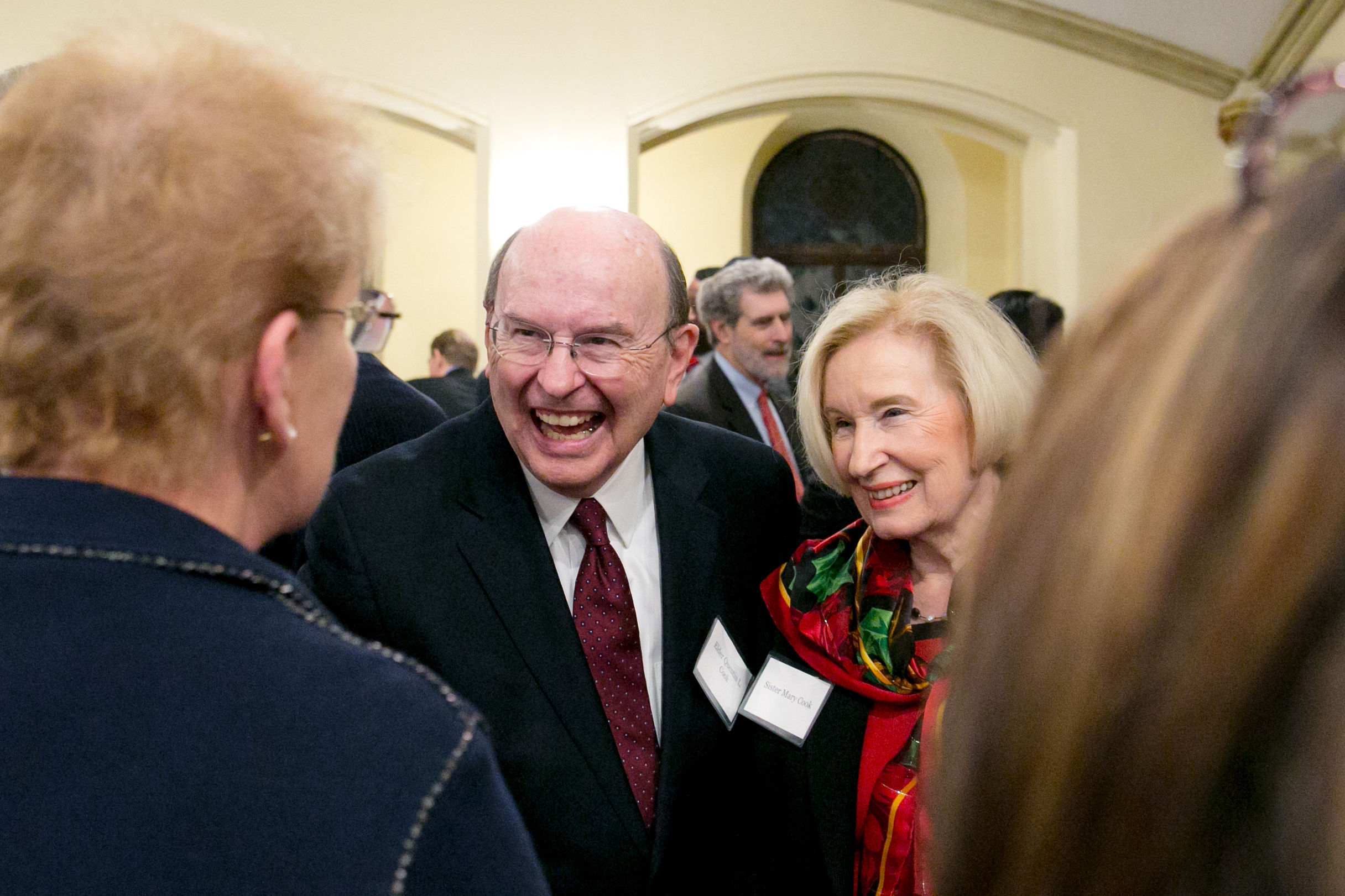 Elder Quentin L. Cook and his wife, Sister Mary G. Cook, visit with guests after the New York Latter-day Saint Professional Association dinner, held in the historic Riverside Chapel in Manhattan on Dec. 18.