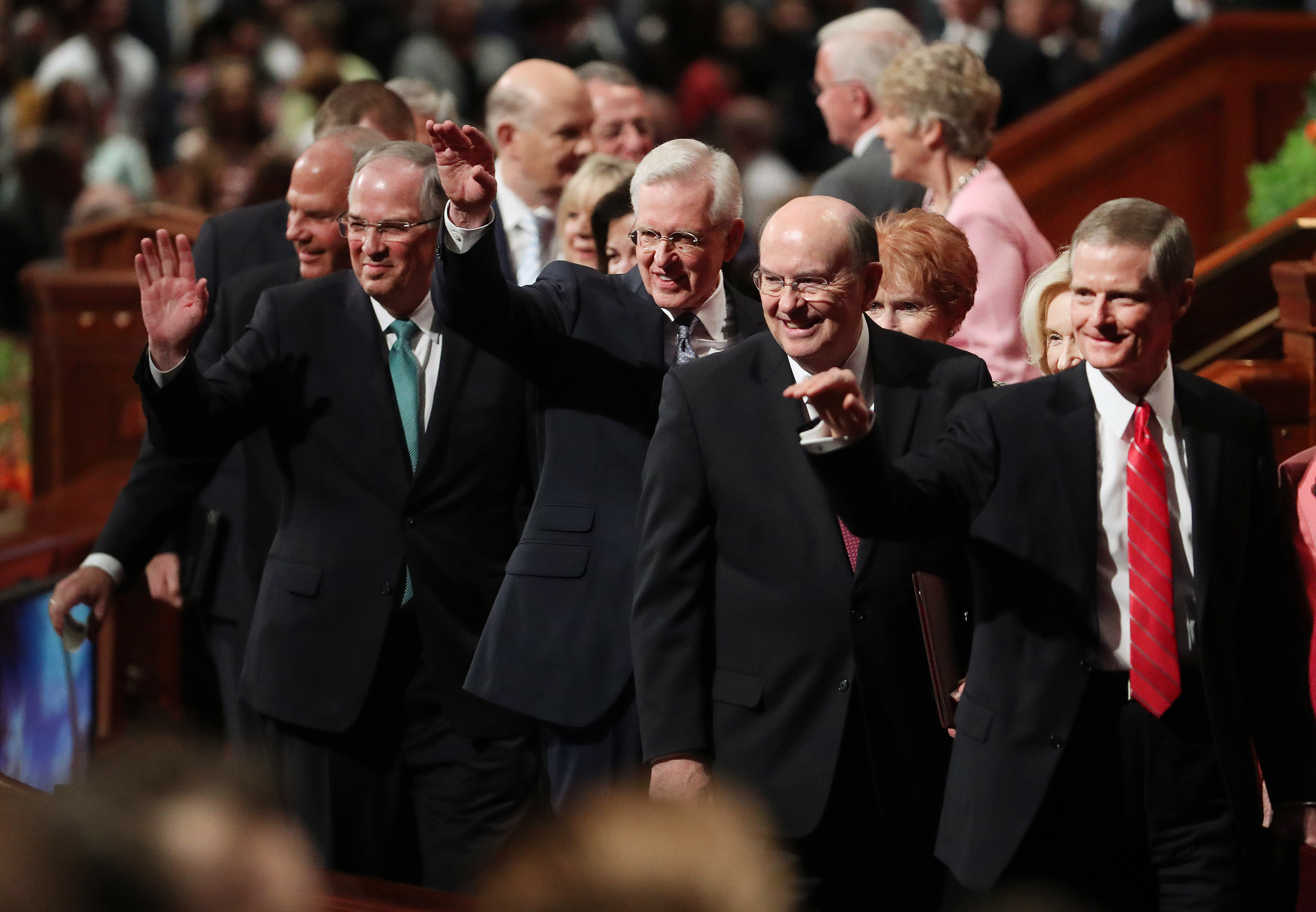 Members of the Quorum of the Twelve Apostles wave to attendees after the Sunday morning session of the 189th Annual General Conference of The Church of Jesus Christ of Latter-day Saints in the Conference Center in Salt Lake City on Sunday, April 7, 2019.
