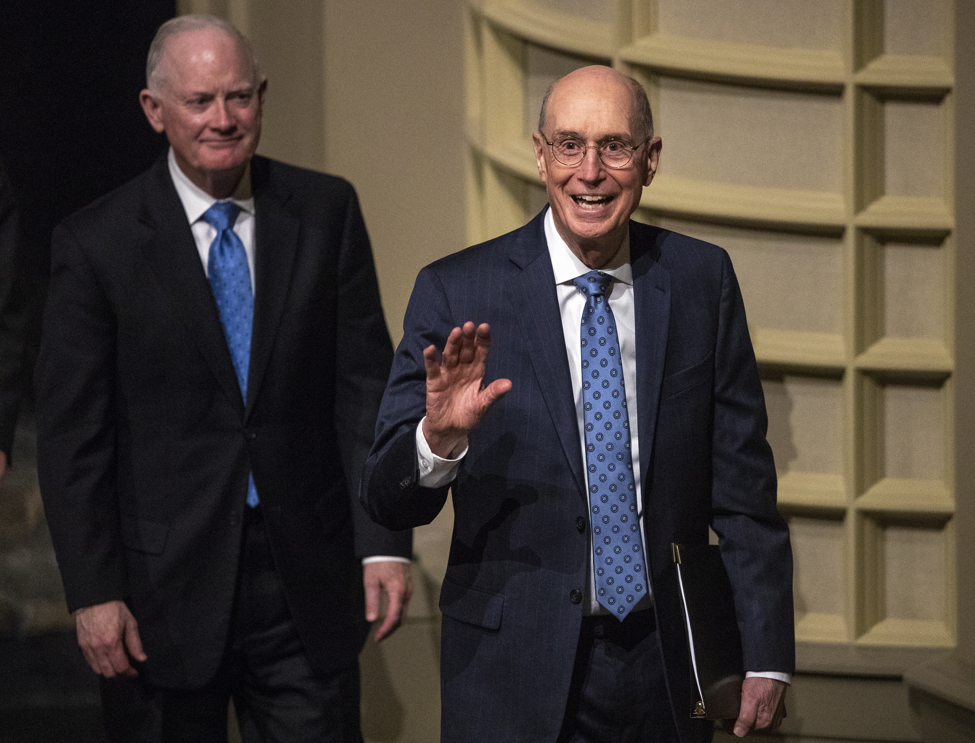 President Henry B. Eyring waves to the crowd as he and Elder Kim B. Clark, general Authority Seventy and commissioner of Church education exit after President Eyring spoke to LDS Business College students at a devotional in the Conference Center theater in Salt Lake City on Tuesday, Nov. 6, 2018.