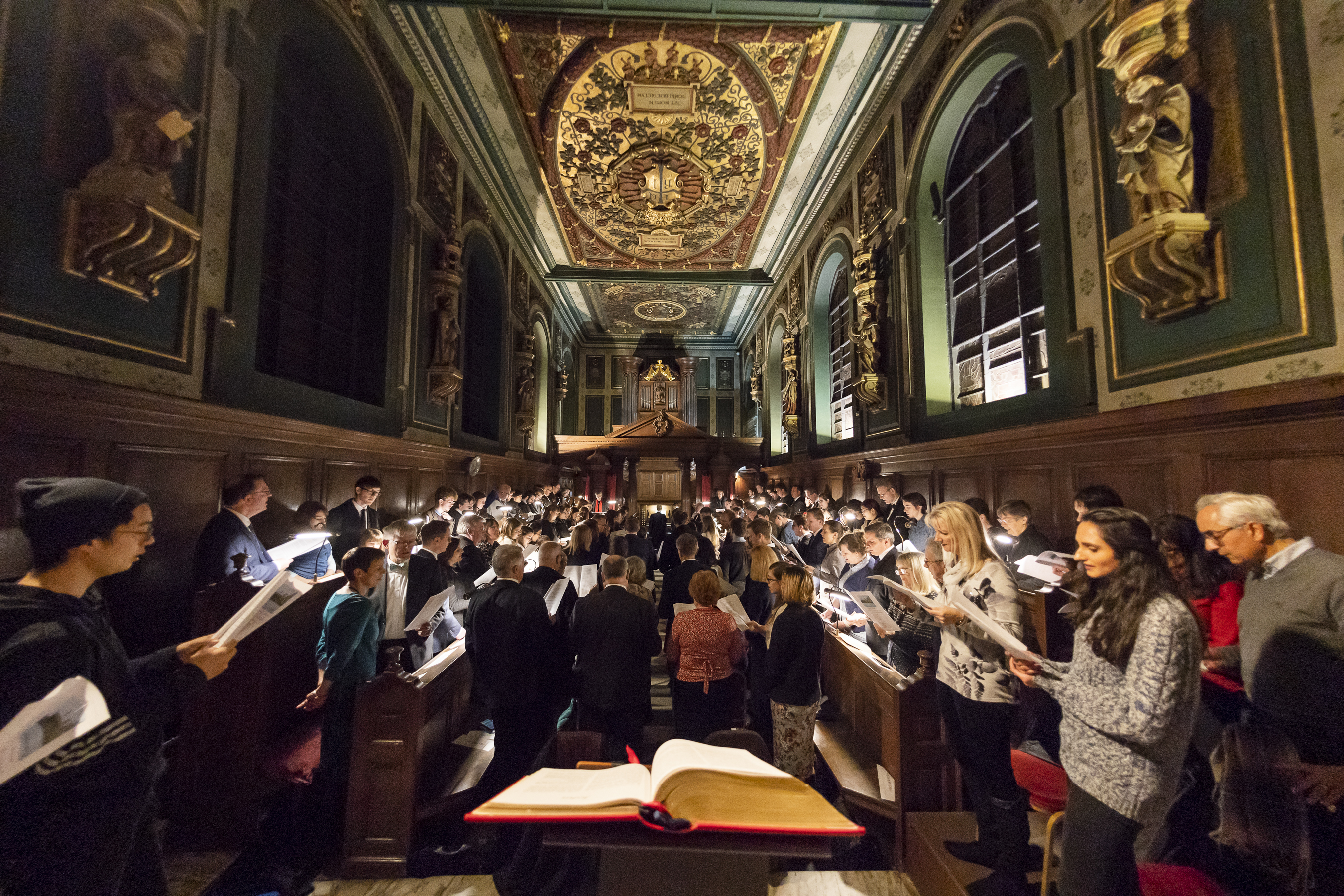 """The congregation sings a Christmas hymn during the traditional Church of England """"Nine Lessons and Carols"""" service at the Pembroke College Chapel in Oxford, England, on Sunday, Nov. 25, 2018."""