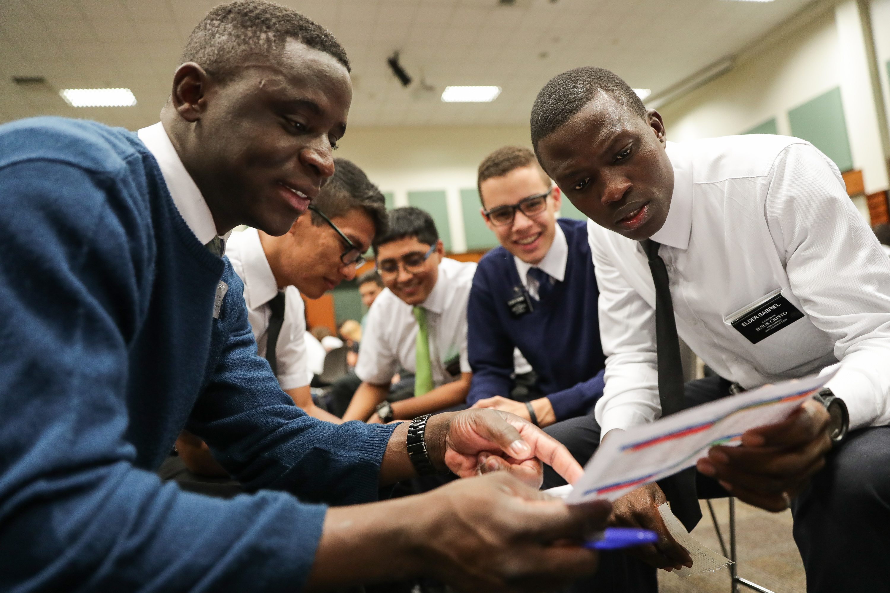 Elder Fernando Armindo Zuca, left, and Elder Jorge Gabriel, right, work with other missionaries on a lesson at the Missionary Training Center in São Paulo, Brazil on Thursday, May 24, 2018.