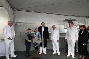 President Thomas S. Monson, second from right, Elder M. Russell Ballard, right, and Elder William R. Walker, left, participate in sealing the Calgary Alberta Temple's cornerstone with two youth, James Varty and Hannah Lawrence.