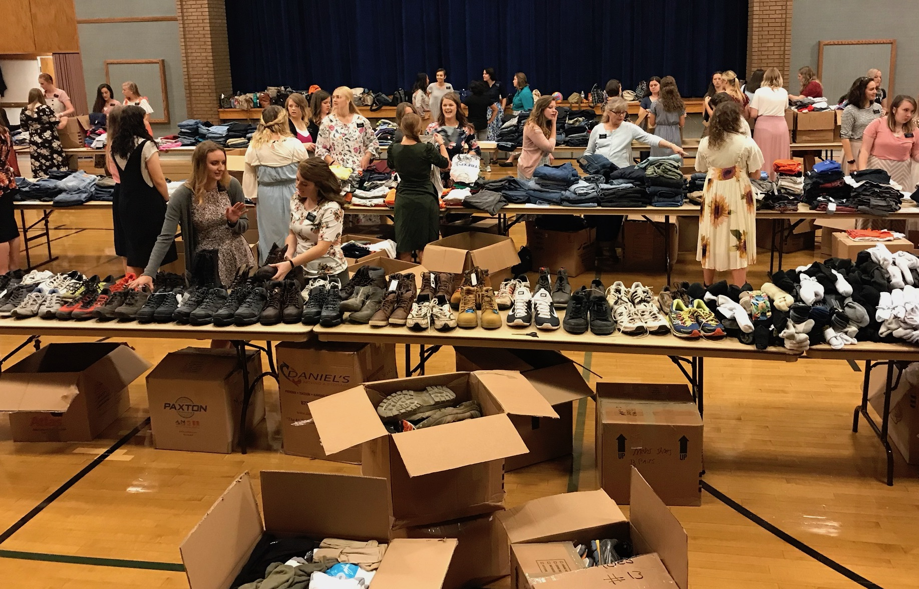 Missionaries from the North Carolina Raleigh Mission sort through work clothes donated by the Oakton Virginia Stake following Hurricane Florence.