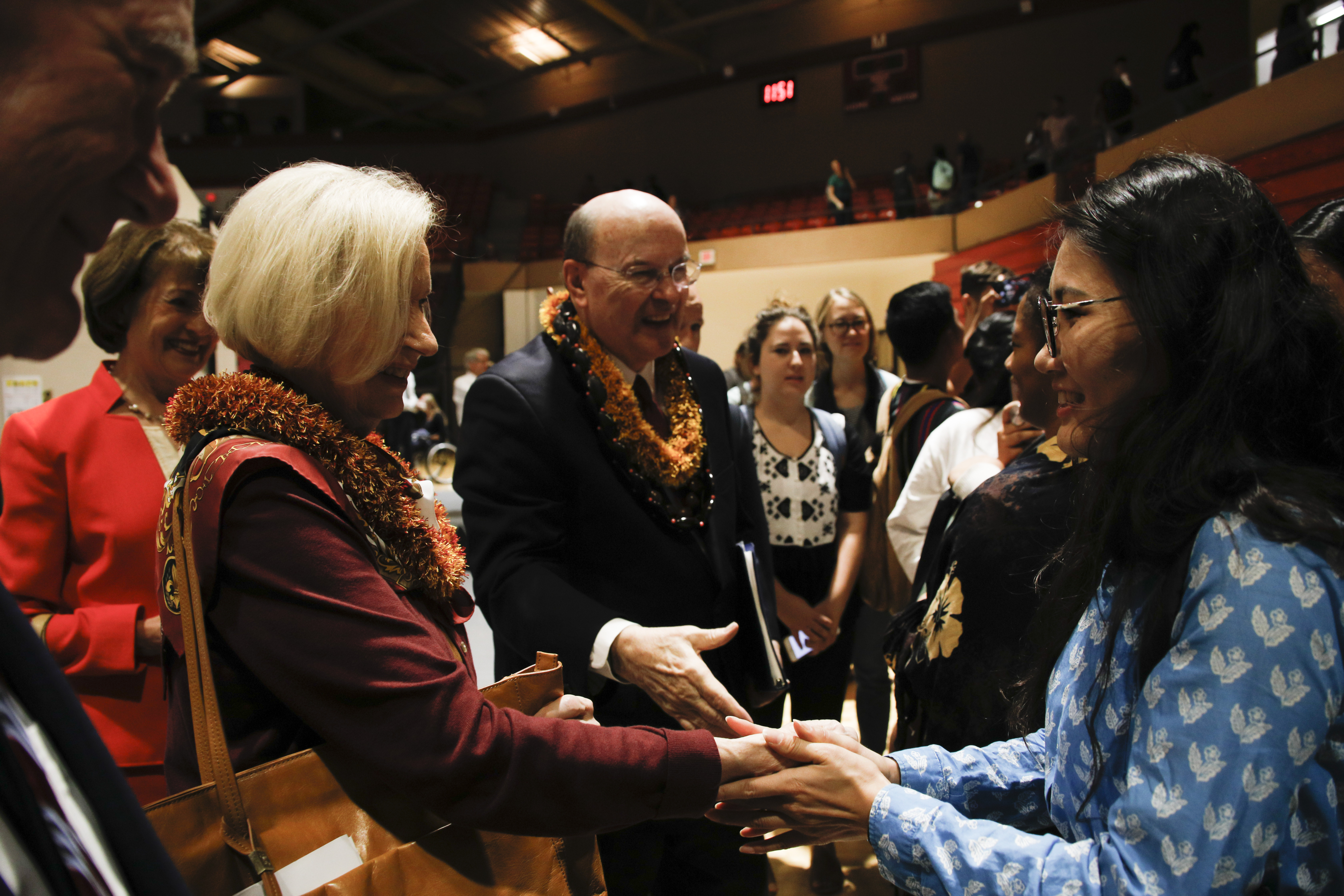 Elder Quentin L. Cook of the Quorum of the Twelve Apostles and his wife, Sister Mary Cook, greet students at a campus devotional at BYU-Hawaii on Nov. 20.