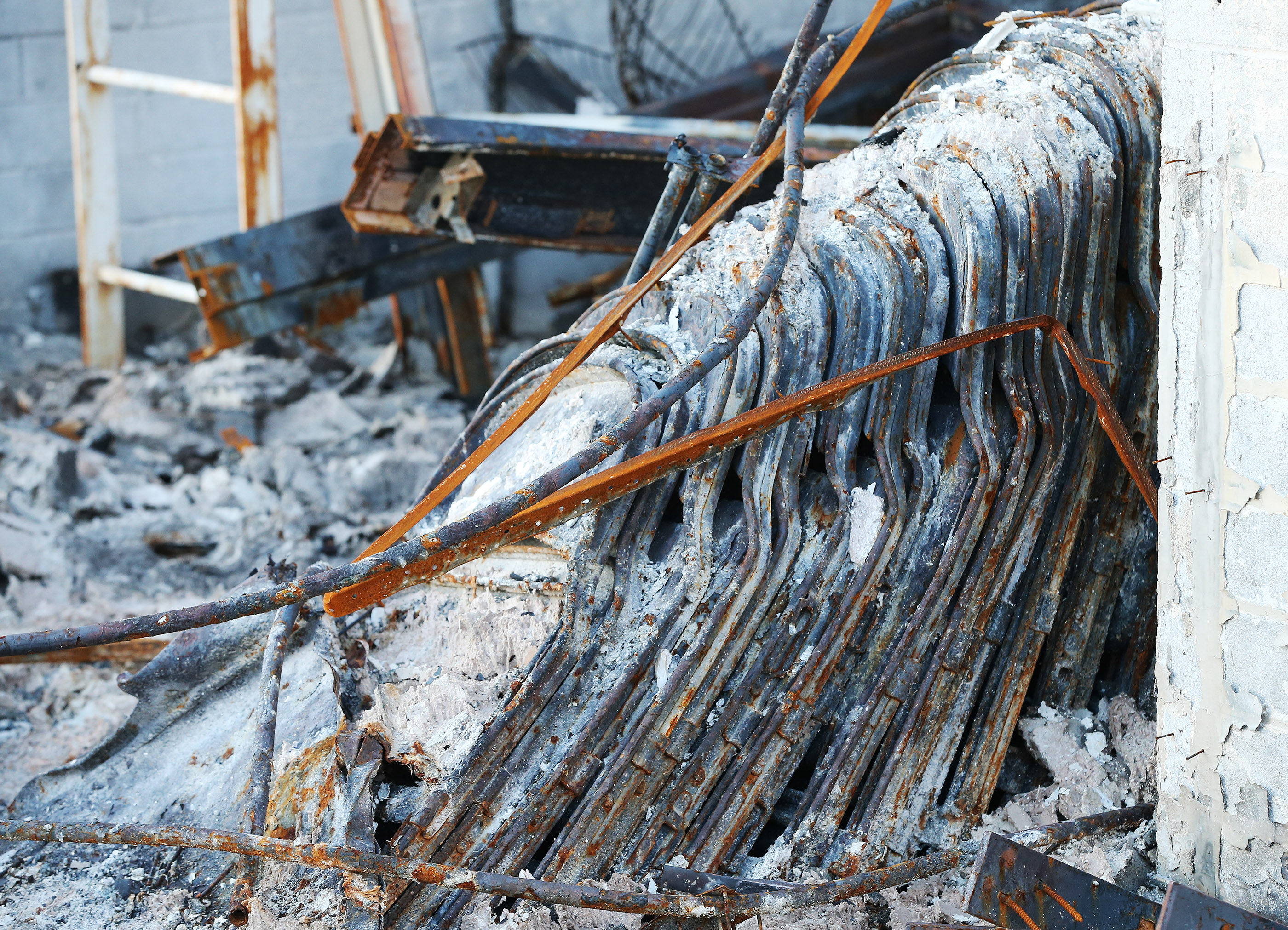 Chairs remained stacked at a burned-out meetinghouse of The Church of Jesus Christ of Latter-day Saints in Paradise, California, on Saturday, Jan. 12, 2019, two months after the Camp Fire destroyed more than 18,000 homes and businesses.