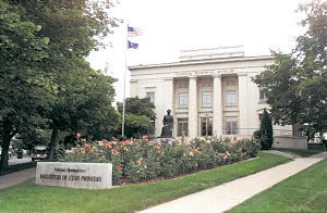 Exterior of the Pioneer Memorial Museum. A statue of Eliza R. Snow in front of the museum stands as a tribute to all Mormon pioneer women.