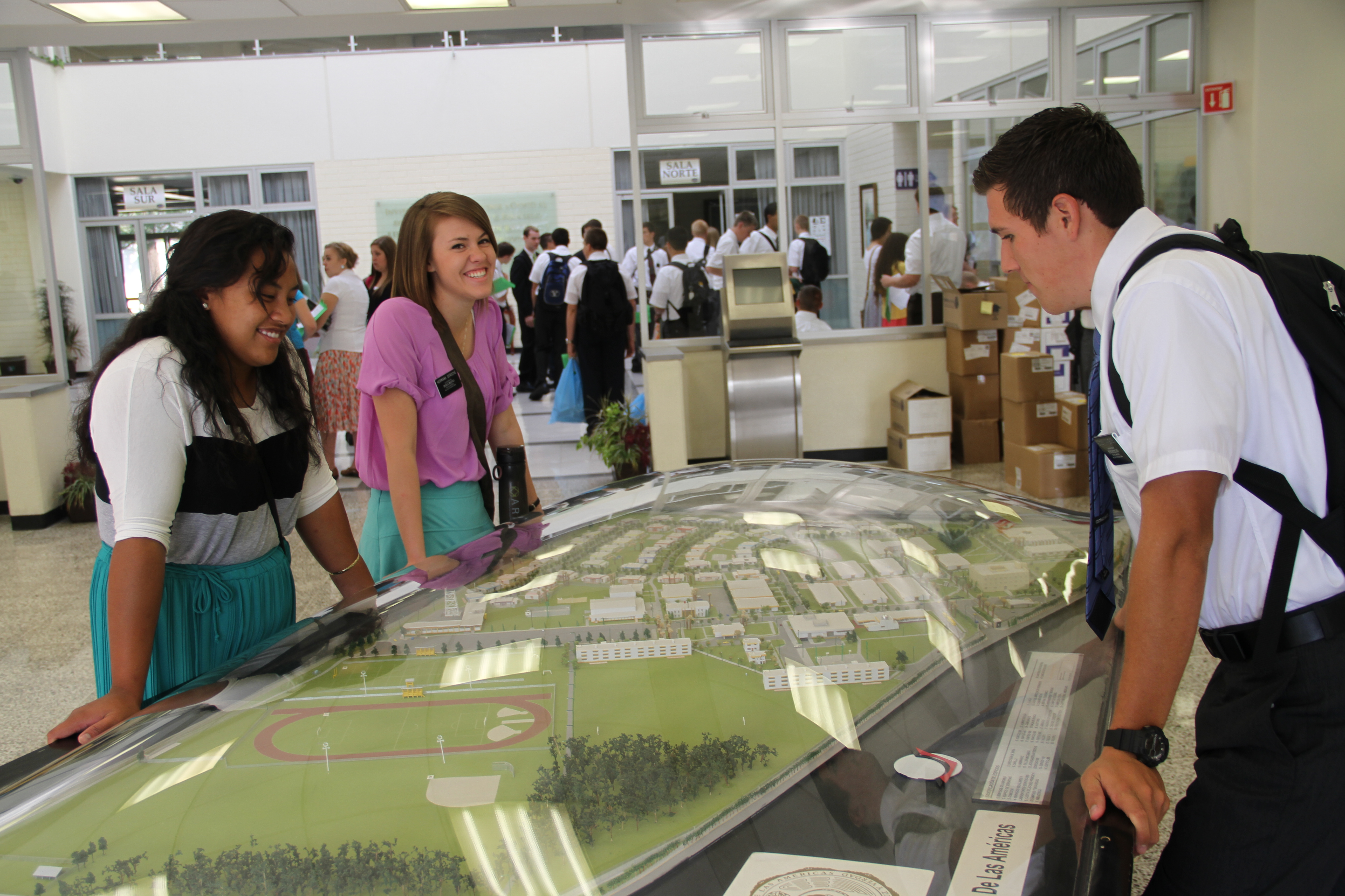 Missionaries study the 3-dimensional map of the Mexico Missionary Training Center in August 2013.