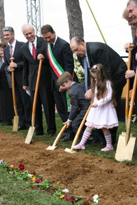 President Thomas S. Monson is assisted by Samuele Lord, 7, and his younger sister, Talia Lord, 5, from Naples, Italy. To President Monson's right is Rome Vice-Mayor Giuseppe Ciardi. To his left is Italian Senator Lucio Malan.