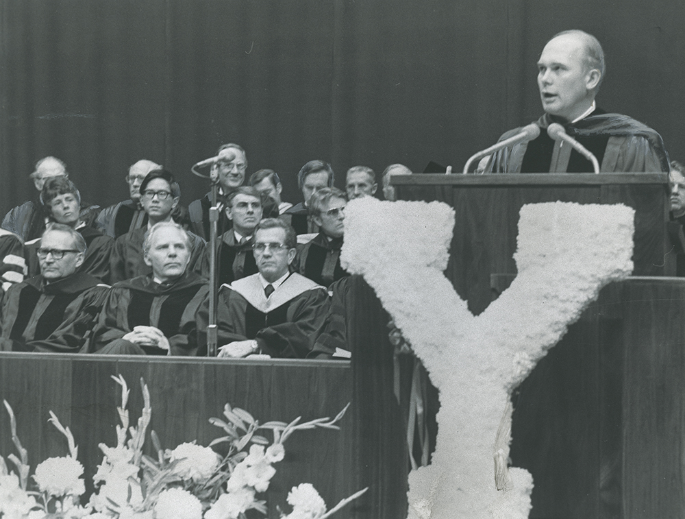 Elder L. Tom Perry, first row left, Rep. Gunn McKay, and Elder Boyd K. Packer hear Pres. Dallin H. Oaks address at the 102nd BYU commencement.