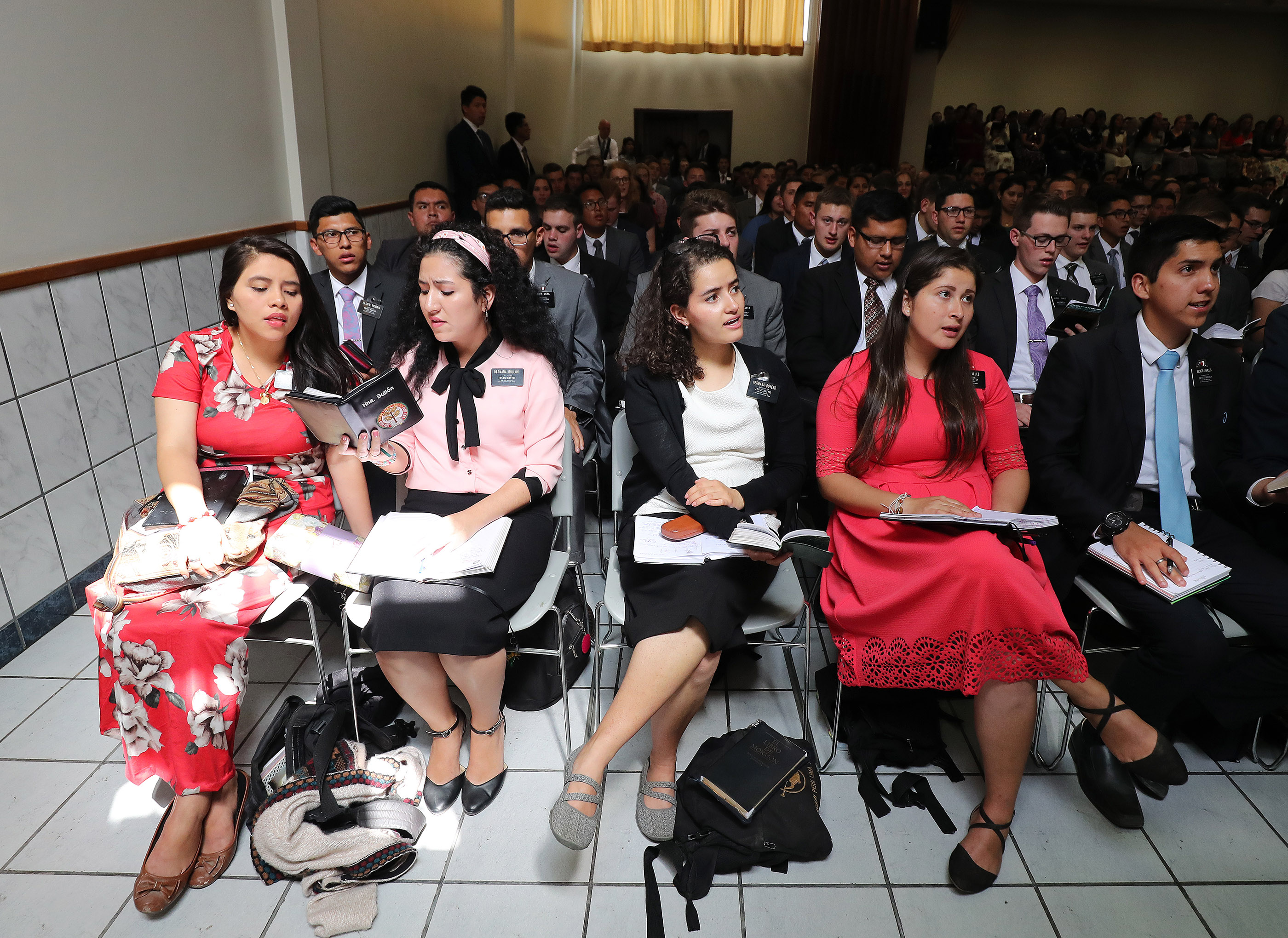 Missionaries sing during a meeting with President Russell M. Nelson of The Church of Jesus Christ of Latter-day Saints and Elder Gary E. Stevenson of the Quorum of the Twelve Apostles in Lima, Peru, on Oct. 20, 2018.