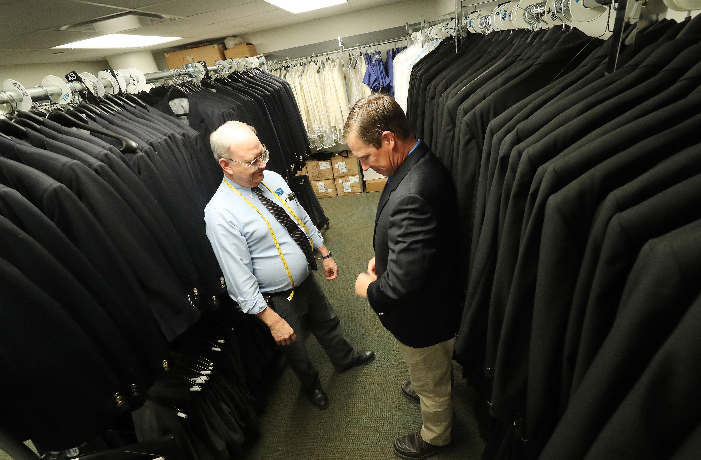 Daniel Wilson, right, gets fitted with a suit by Vance Everett in preparation to sing with The Tabernacle Choir at Temple Square during a rehearsal in Salt Lake City on Thursday, April 11, 2019. Four people were selected through social media to sing with the choir.