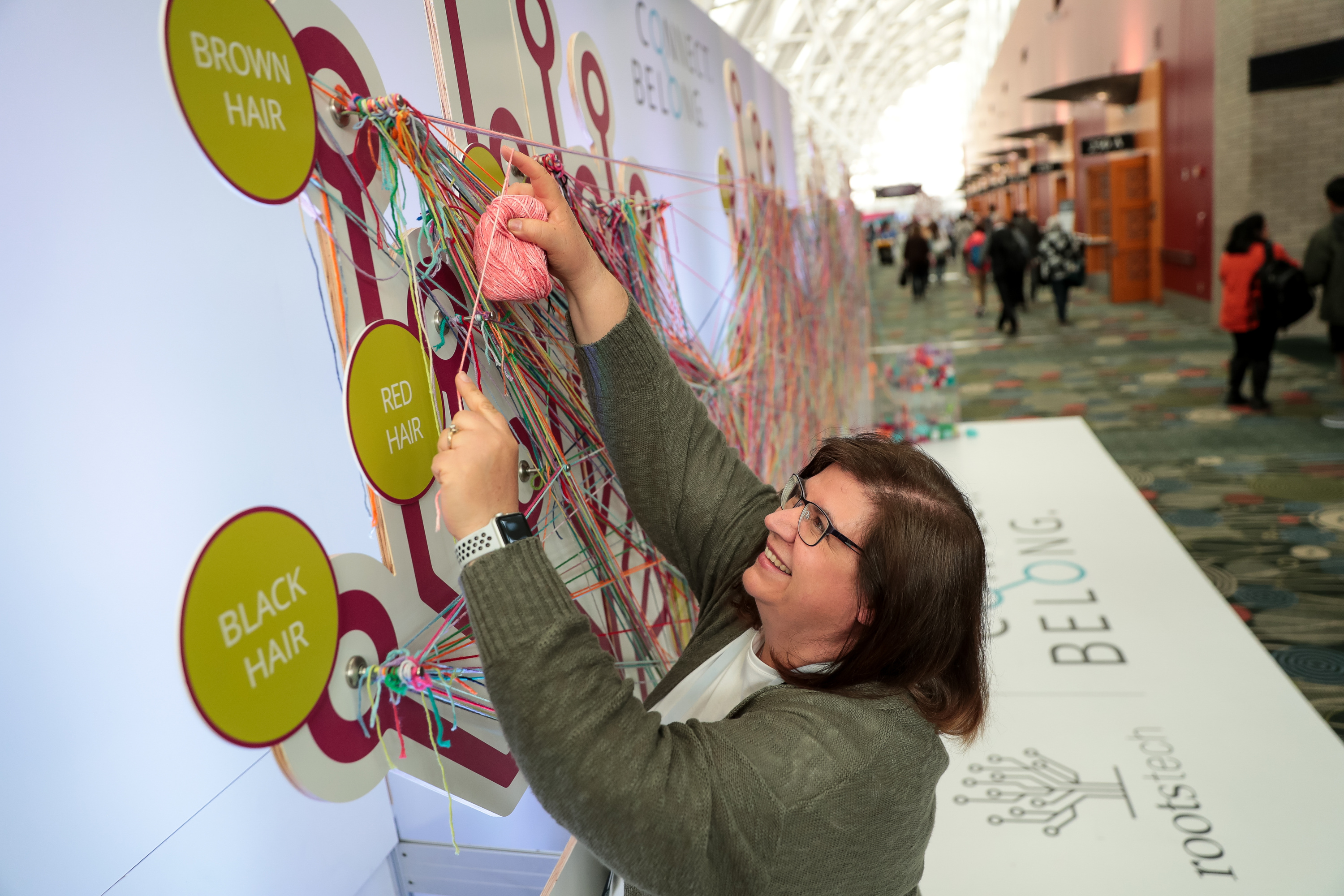 Sandra Hugie interacts with a display at the RootsTech conference at the Salt Palace in Salt Lake City on Friday, March 1, 2019.