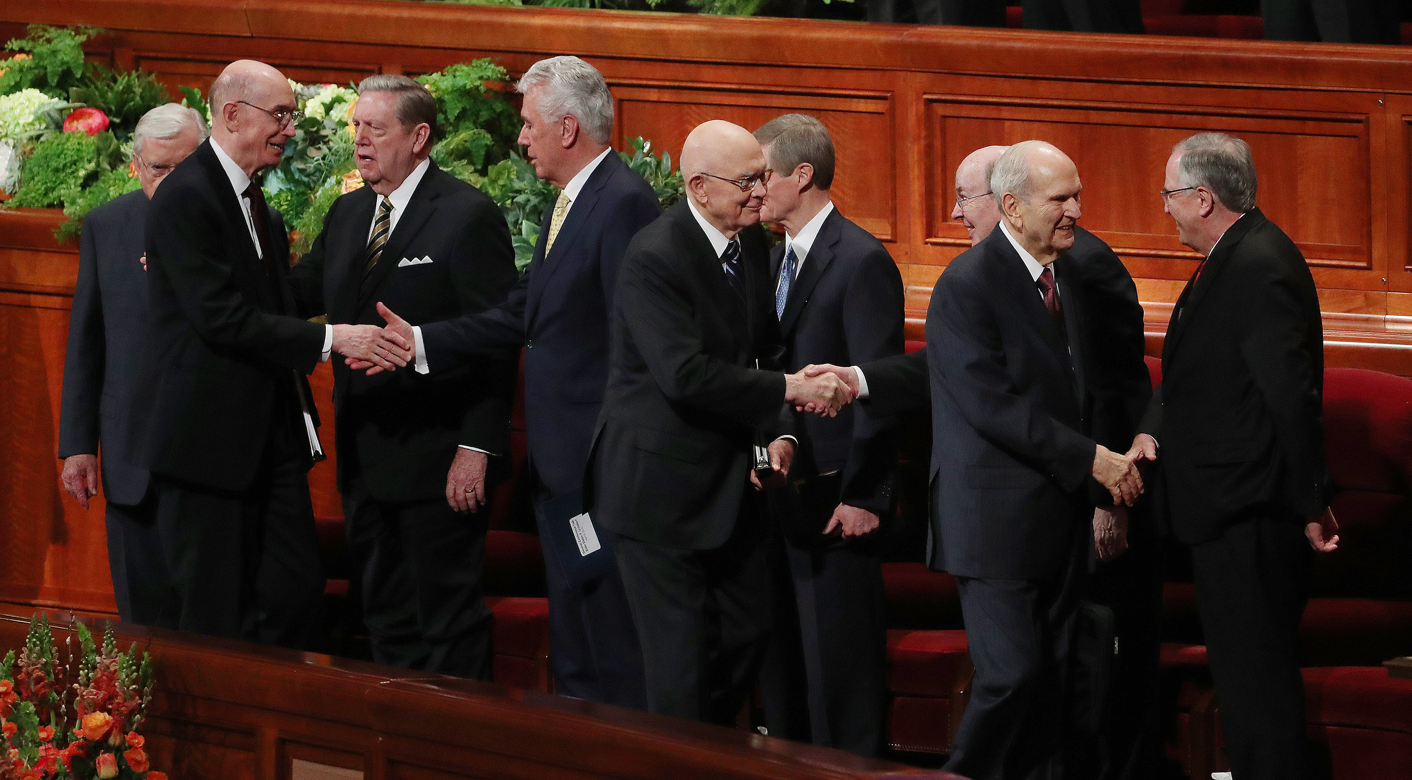 President Russell M. Nelson of The Church of Jesus Christ of Latter-day Saints, right, and his counselors, President Dallin H. Oaks, first counselor in the First Presidency, center, and President Henry B. Eyring, second counselor in the First Presidency, greet others after the first session to the 189th Annual General Conference of The Church of Jesus Christ of Latter-day Saints in Salt Lake City on Saturday, April 6, 2019.