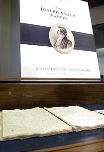 The new volume is displayed along with the original manuscript of the Book of Commandments and Revelation.