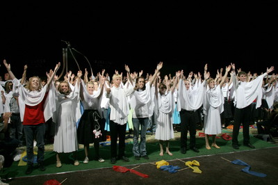In the final moments of the cultural celebration, hundreds of youth — draped in white capes — celebrated the coming of a temple to eastern Arizona.