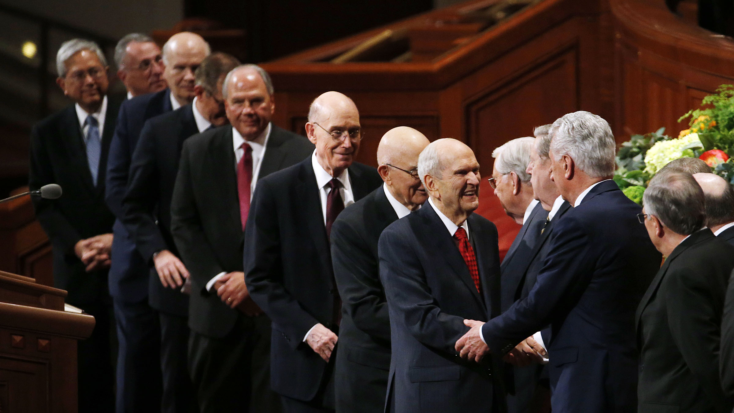 President Russell M. Nelson of The Church of Jesus Christ of Latter-day Saints, facing camera, shakes hands with Elder Dieter F. Uchtdorf of the Quorum of the Twelve Apostles, as he leaves the Conference Center following the priesthood session of the 189th Annual General Conference in the Conference Center in Salt Lake City on Saturday, April 6, 2019.