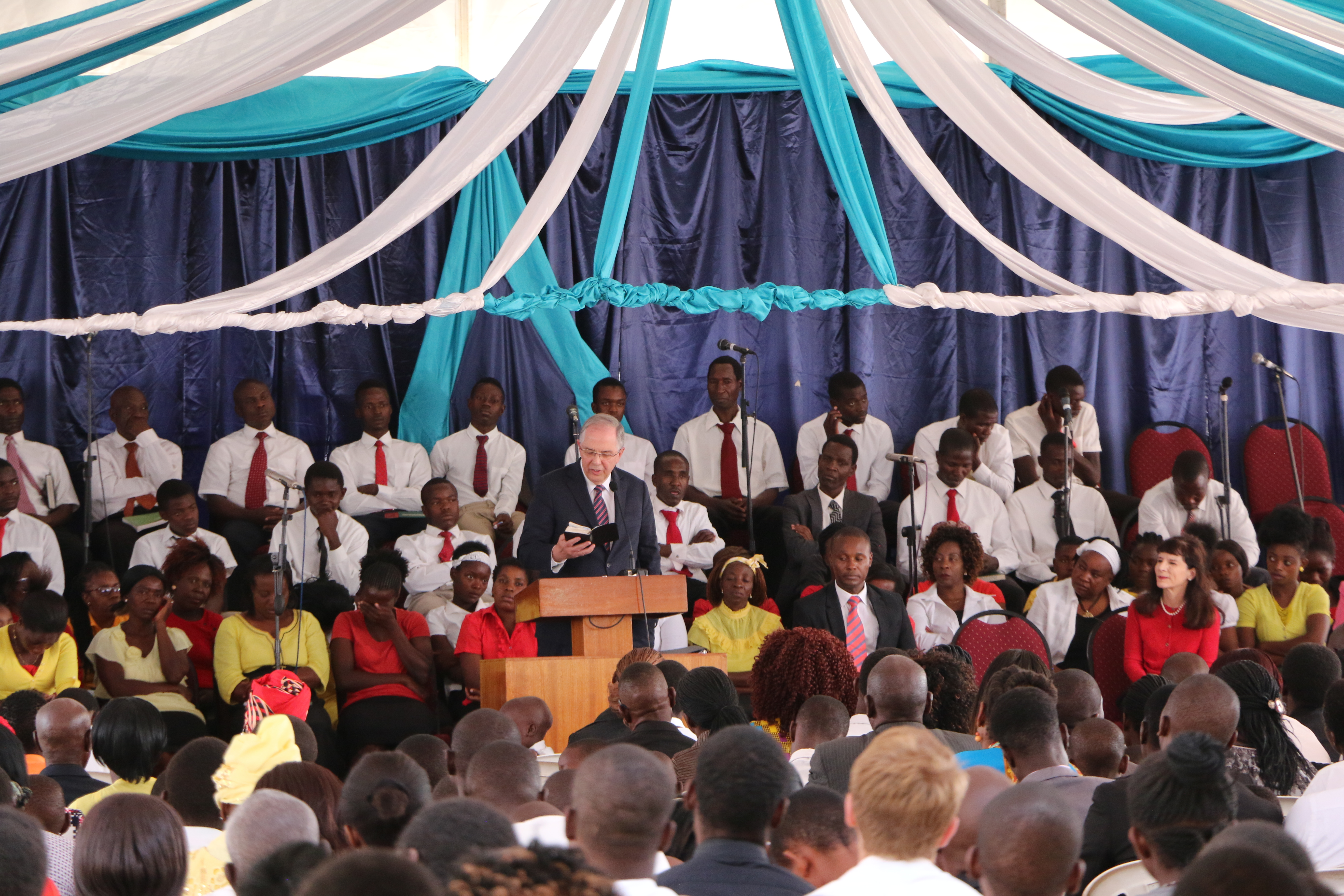 Elder Neil L. Andersen of the Quorum of the Twelve Apostles, center with Sister Kathy Andersen participate in a member meeting in Zimbabwe on Nov. 18. 2018.