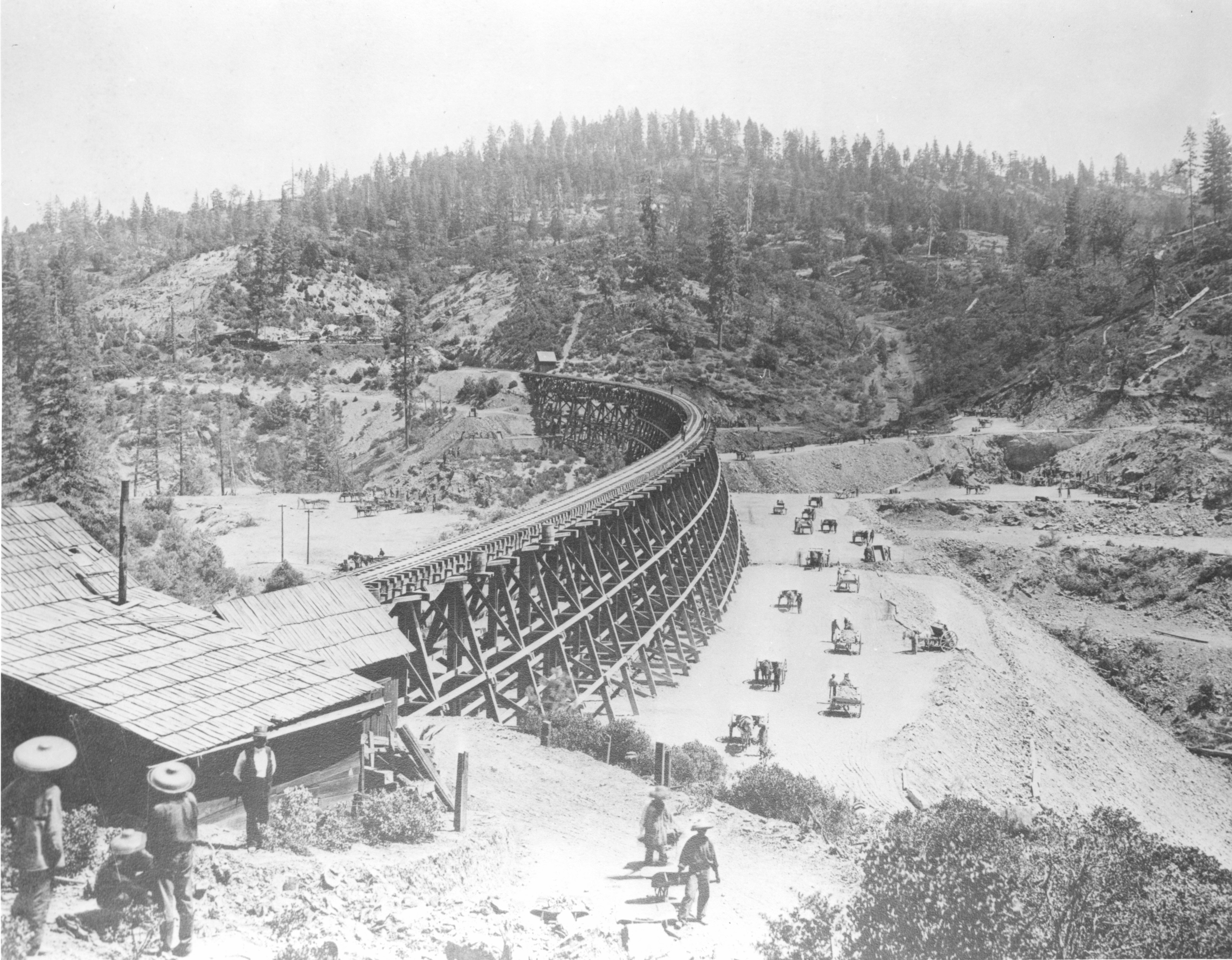 The Central Pacific Railroad builds a bridge over Sacramento Ravine in 1877.