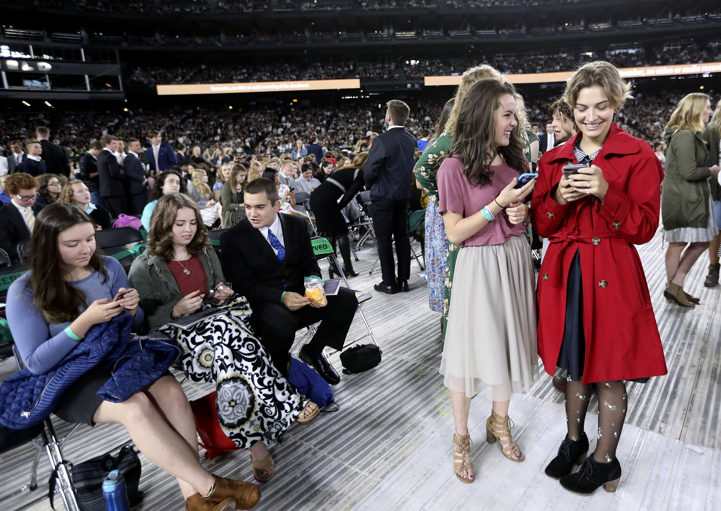 Teens wait for President Russell M. Nelson of The Church of Jesus Christ of Latter-day Saints to speak at Safeco Field in Seattle, Wash., on Saturday, Sept. 15, 2018.