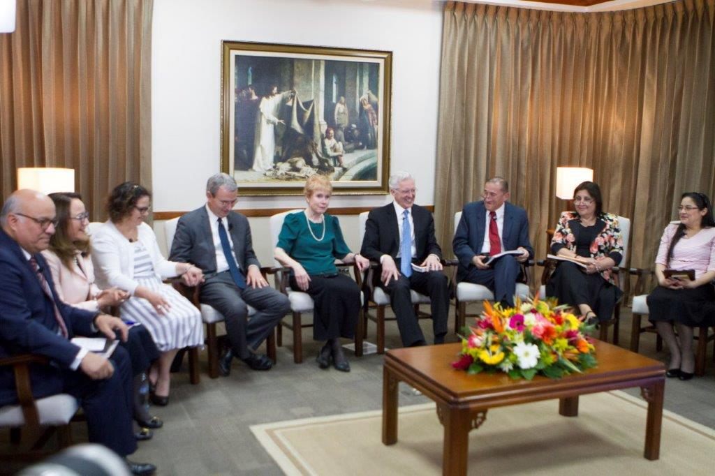 Elder D. Todd Christofferson and Sister Kathy Christofferson join other General Authorities and their wives for a family home evening broadcast to the Central America Area. The discussion focused on how to improve home-centered gospel learning.