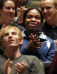 Rosine T. Camah, an East High School student at center of photo, reacts during a music video performance as the Mormon Tabernacle Choir announces the launch of its new YouTube channel in Salt Lake City, Tuesday, Oct. 30, 2012.