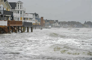 Ocean waves kick up along the shoreline in Milford, Conn., Monday, Oct. 29, 2012.