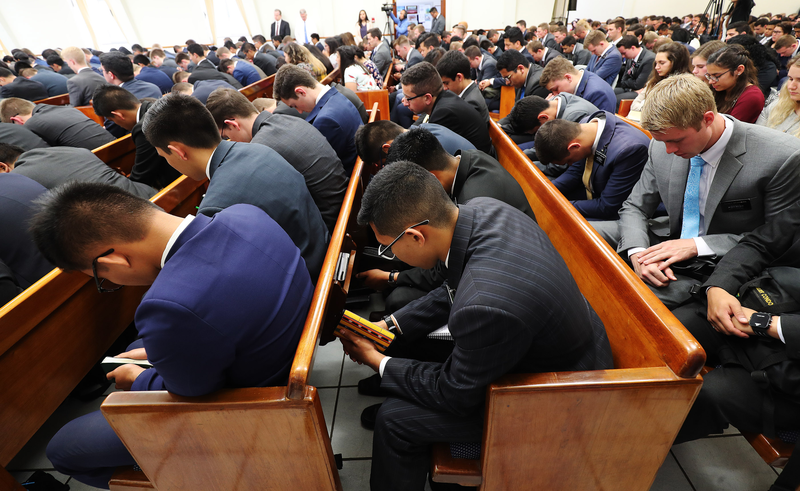 Missionaries listen to the prayer during meeting with President Russell M. Nelson of The Church of Jesus Christ of Latter-day Saints and Elder Gary E. Stevenson of the Quorum of the Twelve Apostles in Lima, Peru, on Oct. 20, 2018.