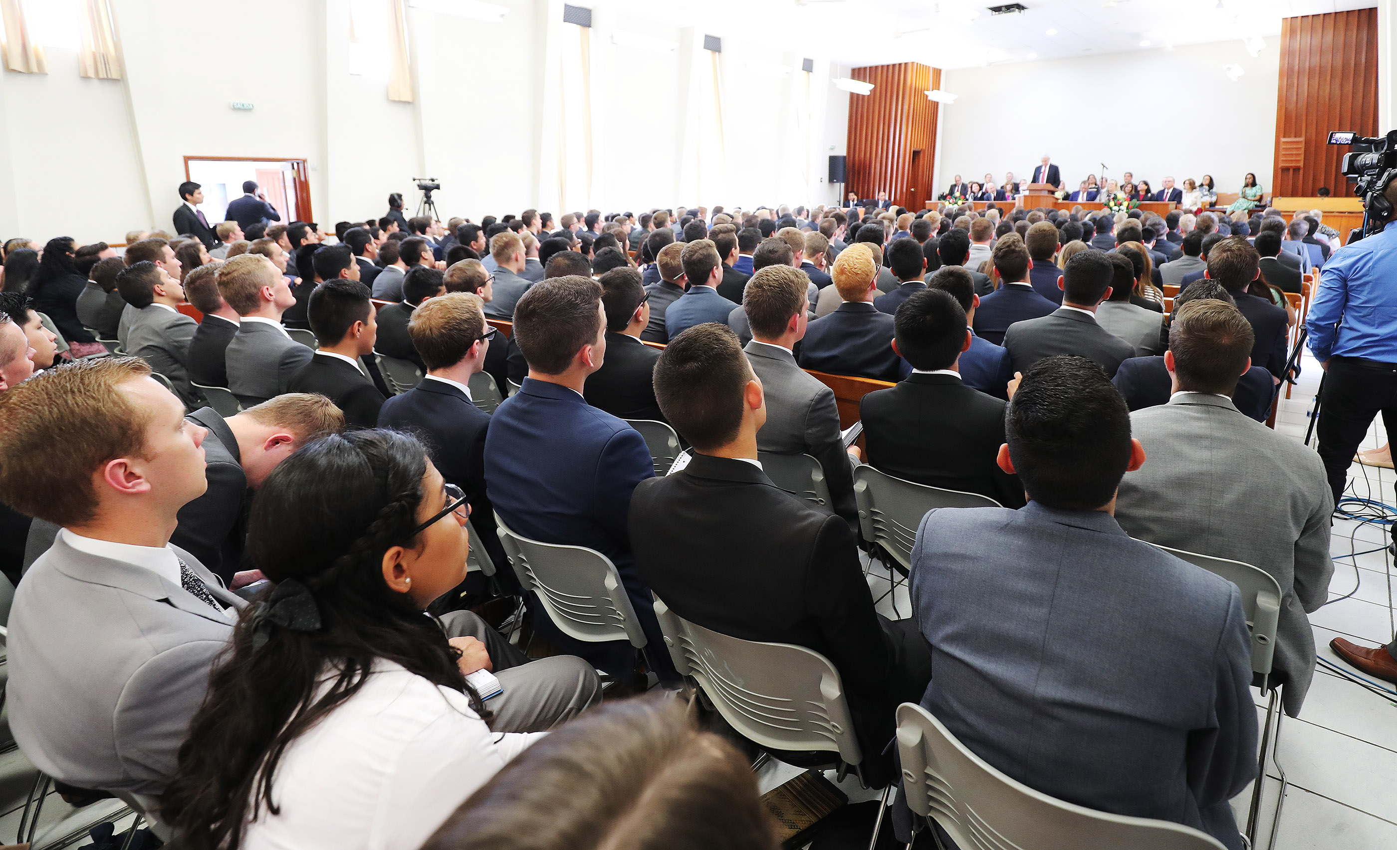 Missionaries listen during meeting with President Russell M. Nelson of The Church of Jesus Christ of Latter-day Saints in Lima, Peru, on Oct. 20, 2018.