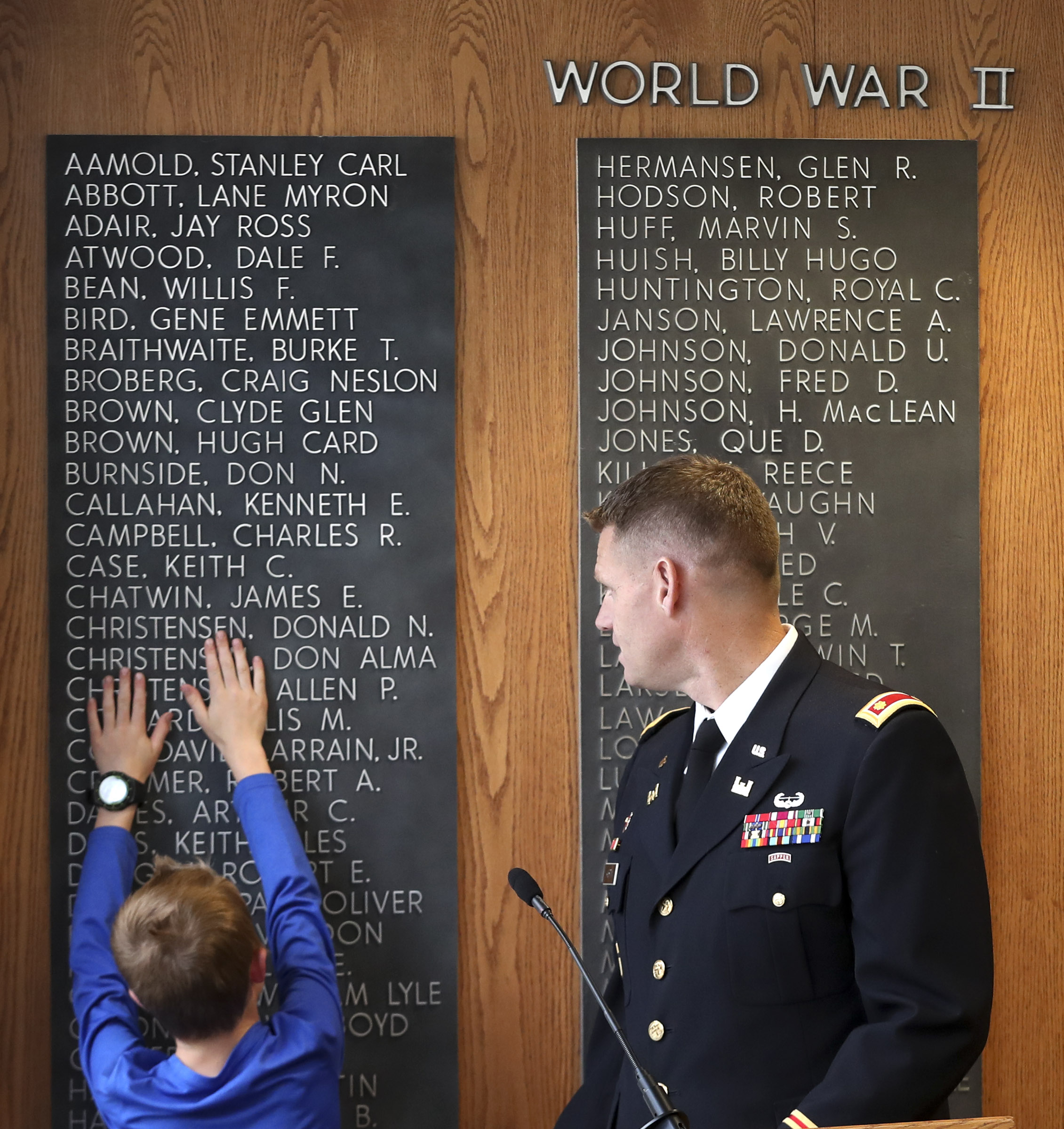 Jacob Taylor touches names on the Reflection Room Memorial Wall in the Wilkinson Center prior to a ceremony where the name of his late father, Maj. Brent Taylor, was added to the wall on the BYU campus in Provo on Thursday, May 23, 2019. Taylor was killed in Afghanistan in 2018.
