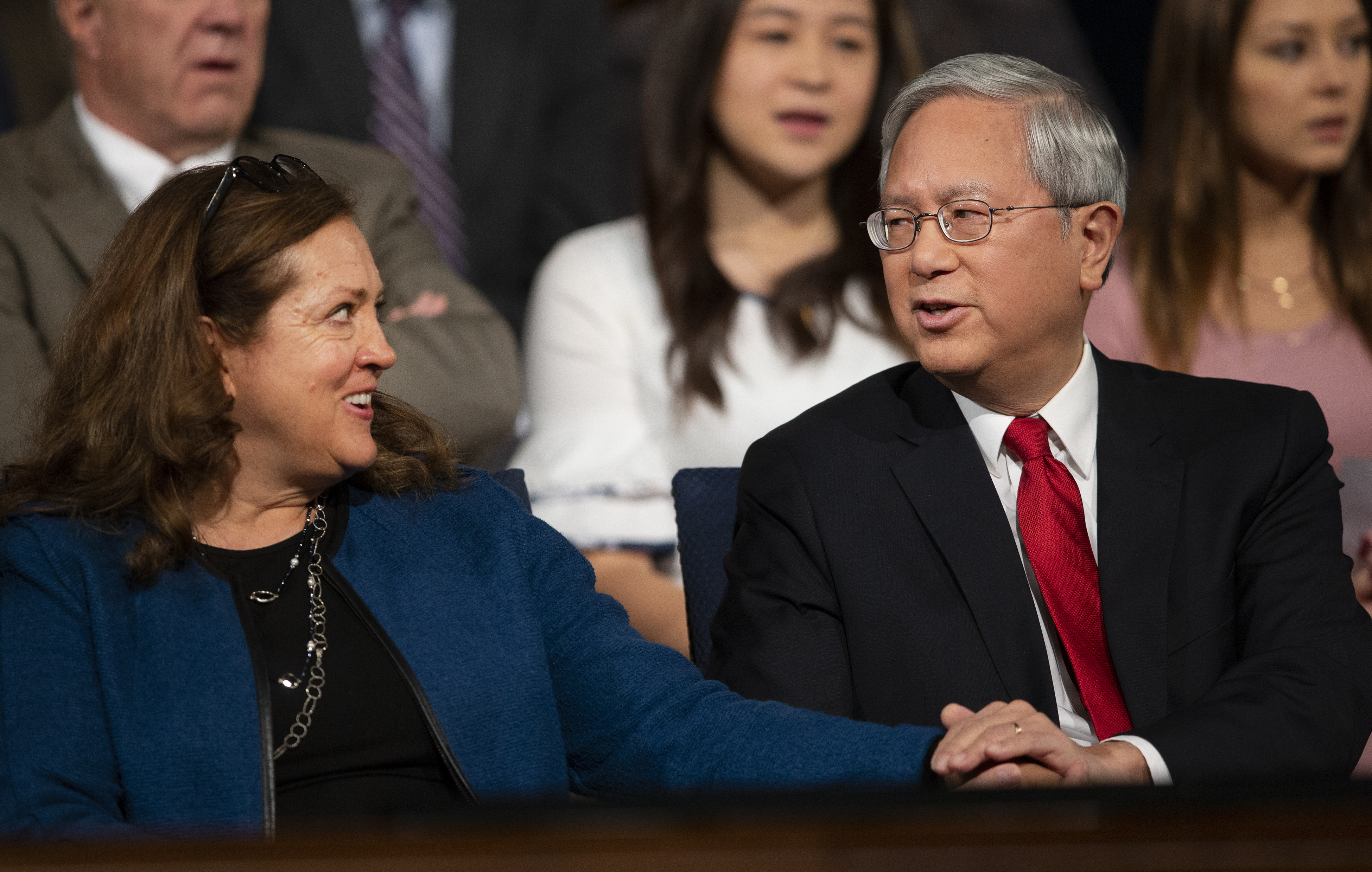 Sister Susan Gong looks over at her husband, Elder Gerrit W. Gong of the Quorum of the Twelve Apostles, prior to him speaking at a BYU campus devotional on Tuesday, Oct. 16, 2018.