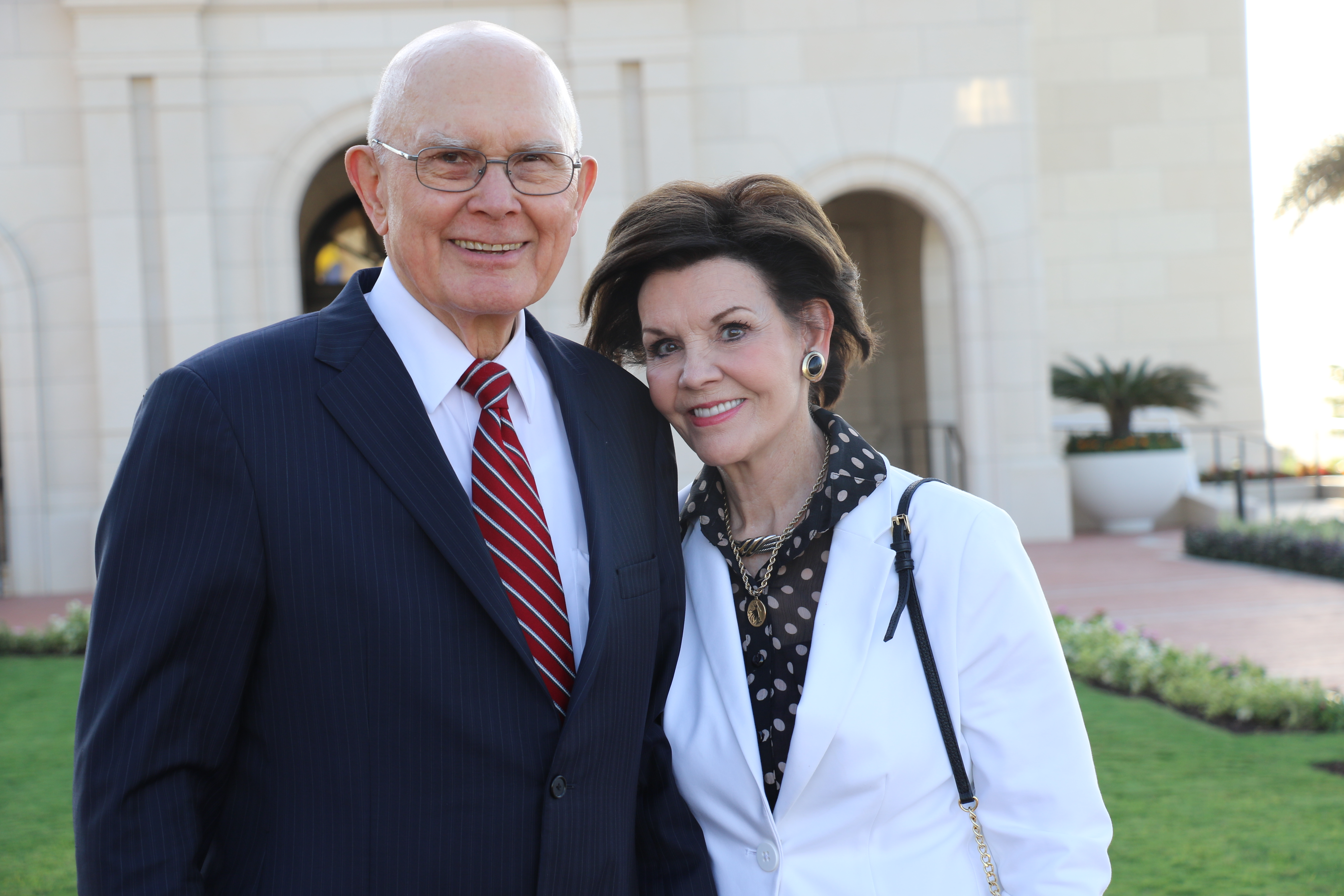 President Dallin H. Oaks, first counselor in the First Presidency, and Sister Kristen Oaks pause for a photo outside the Barranquilla Colombia Temple.