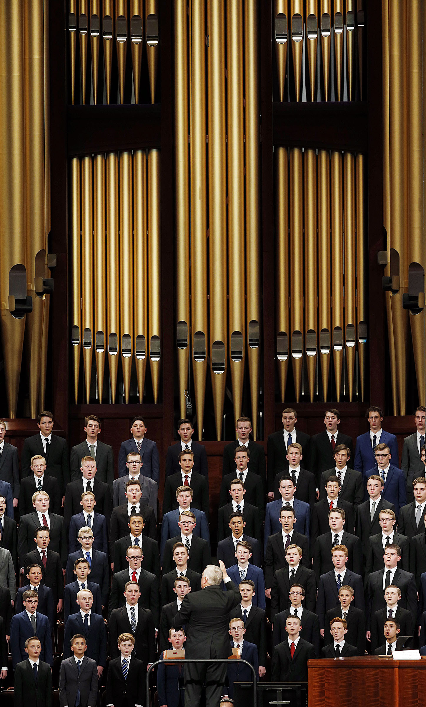 An Aaronic Priesthood choir from stakes in Layton, Utah, sings during the priesthood session of the 189th Annual General Conference of The Church of Jesus Christ of Latter-day Saints in the Conference Center in Salt Lake City on Saturday, April 6, 2019.