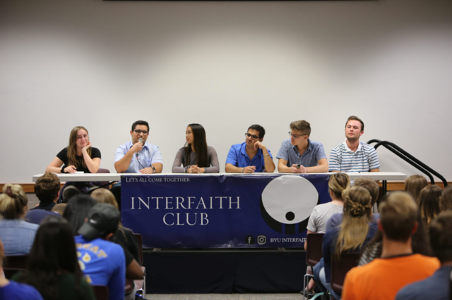 Muslim student Laith Habahbeh, second left, answers a submitted question read by Co-President Arianna Davidson, left, while other panelists, Evelyn Camat-Crisostomo, Jatinder Singh, Jack Bohm and Sam Aden listen.