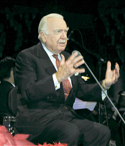 Walter Cronkite delivers war-story narrative.