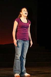 Desirae Gonzalez, singing a solo on stage, was one of the lead performers in the youth show.