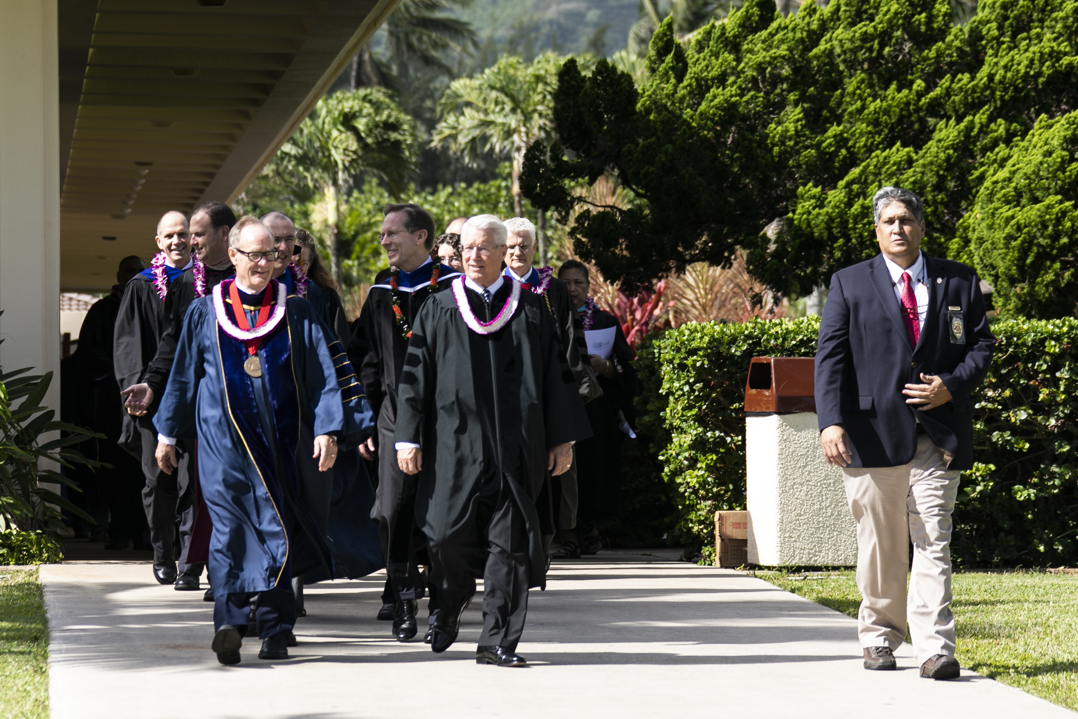 Bishop Dean M. Davies of the Presiding Bishopric, right, walks with BYU-Hawaii President John S. Tanner prior to graduation on June 30.