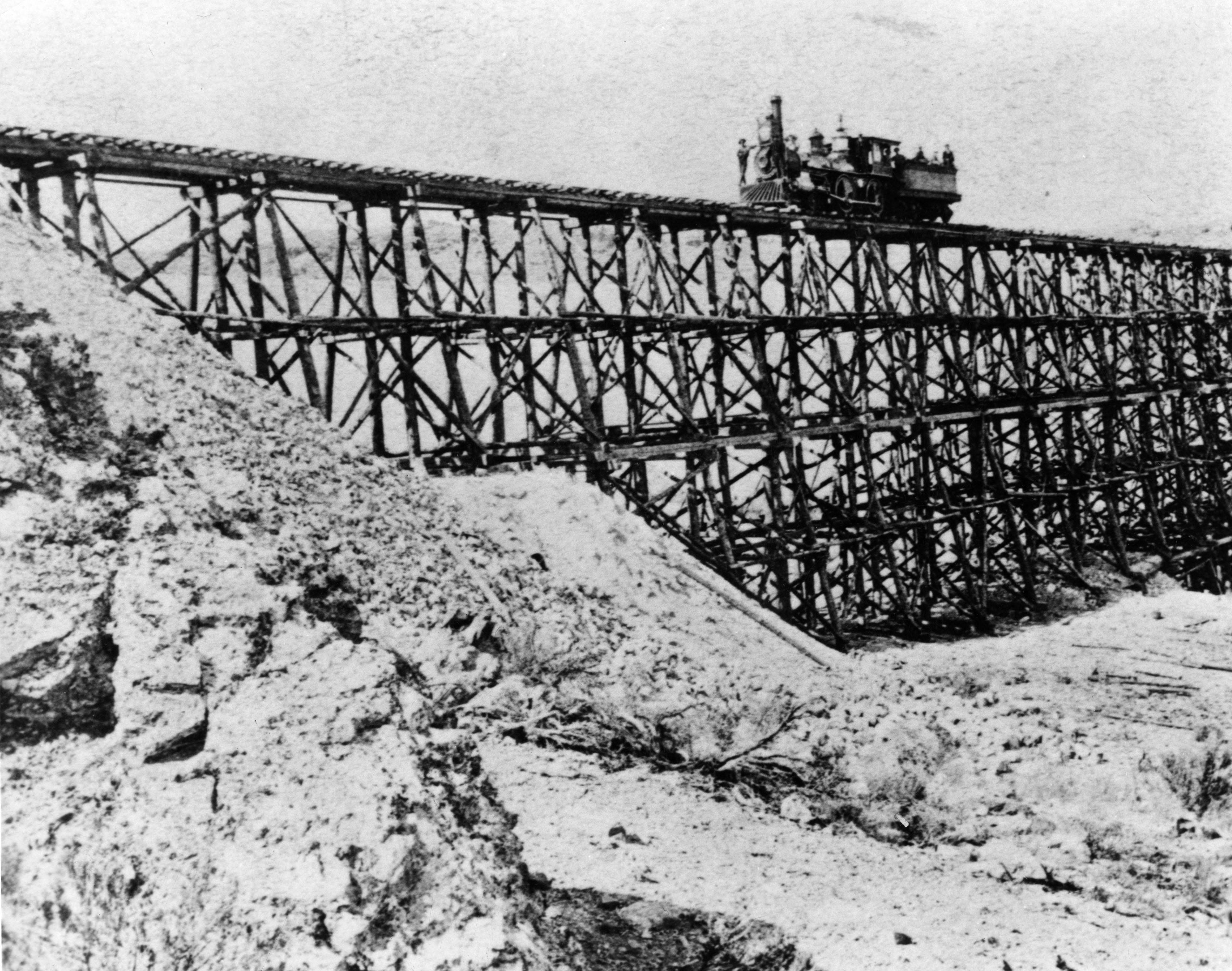 Trestle Union Pacific No. 119 drives on the high trestle on the east slope of the North Promontory Range in 1869.