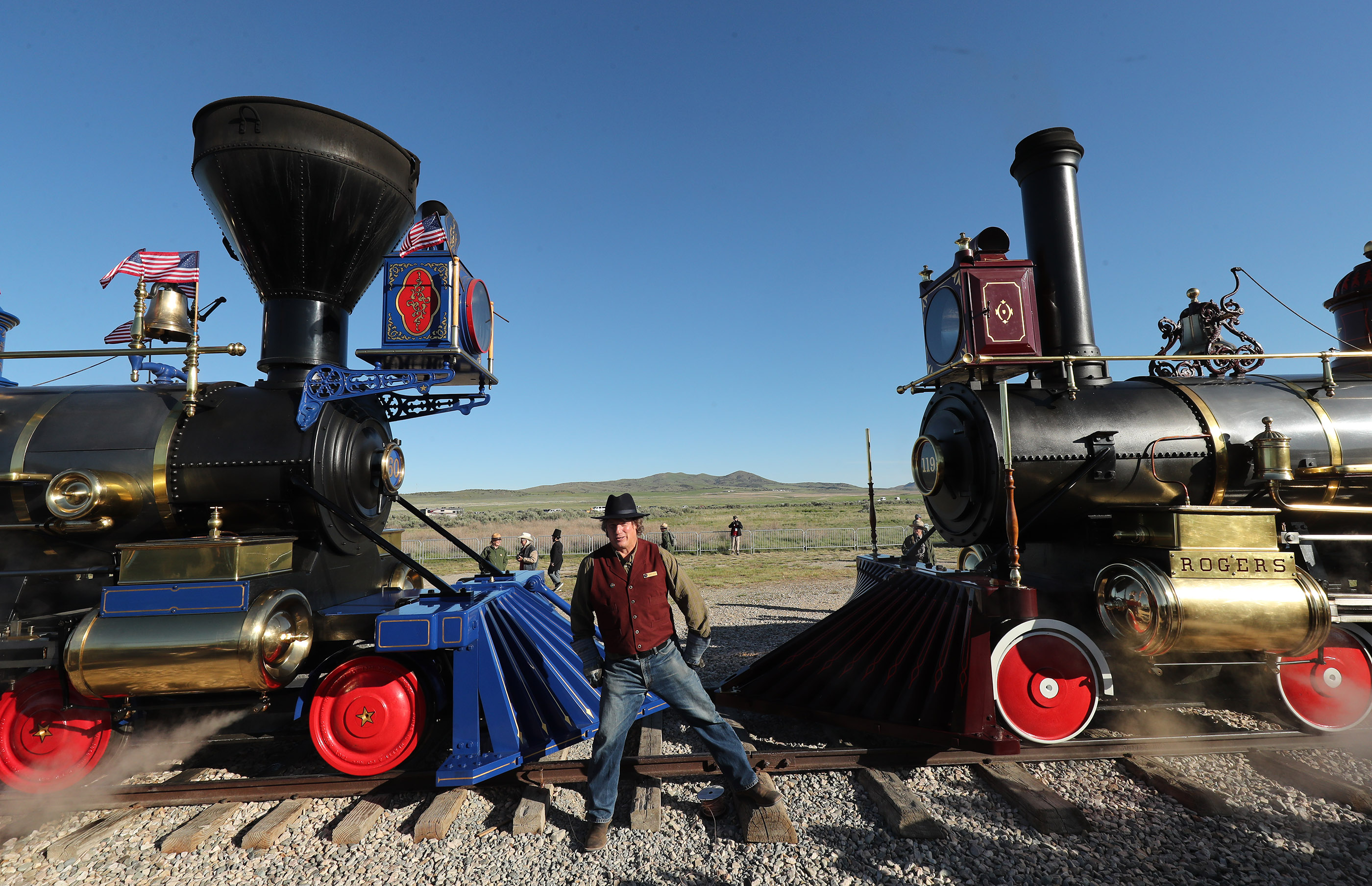Volunteer Patrick Jeffrey stands near the Jupiter and No. 119 engines during the 150th anniversary celebration at the Golden Spike National Historical Park at Promontory Summit on Friday, May 10, 2019.