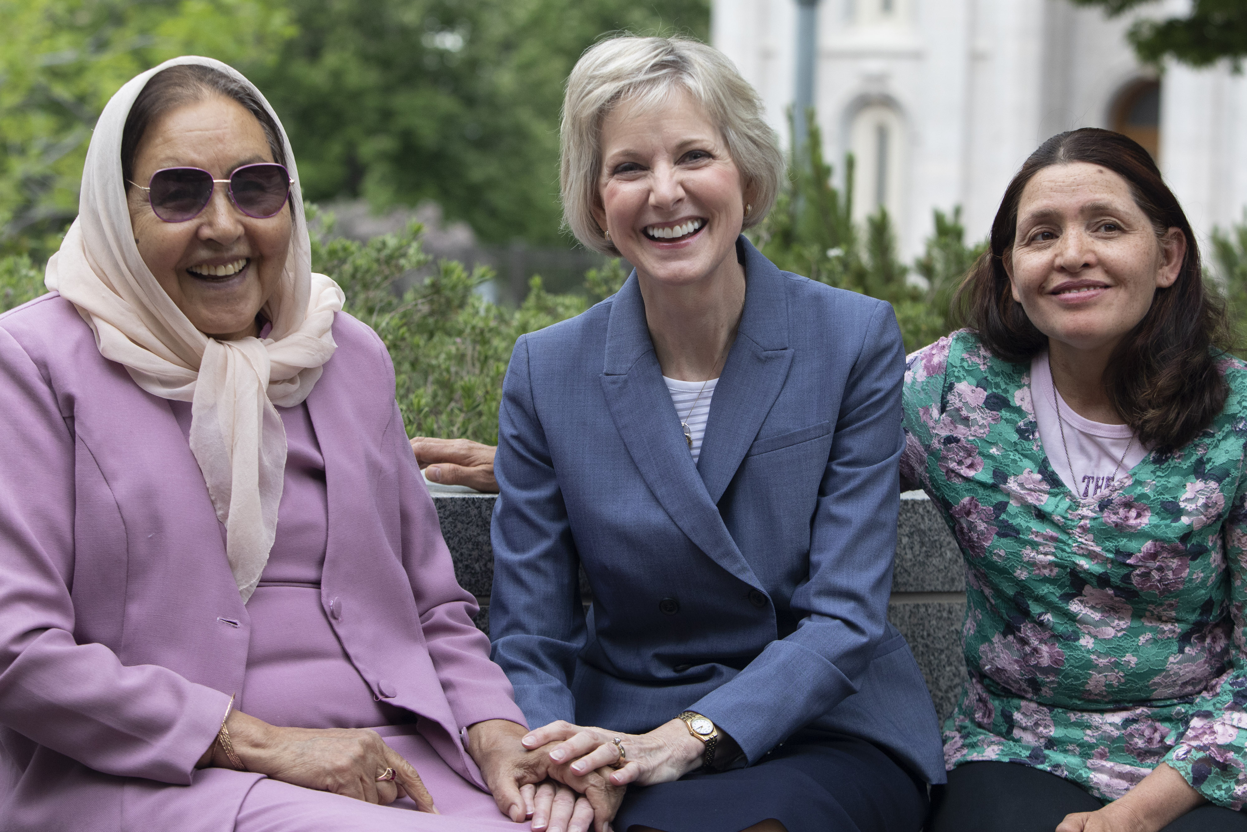 Sister Jean B. Bingham sits with Asifa Nadir, left, and Nadira Nadir outside the Relief Society Building on Temple Square prior to an interview with representatives from USA for UNHCR on May 16, 2019. Sister Bingham has known the Nadir family, refugees from Afghanistan for nearly 15 years.