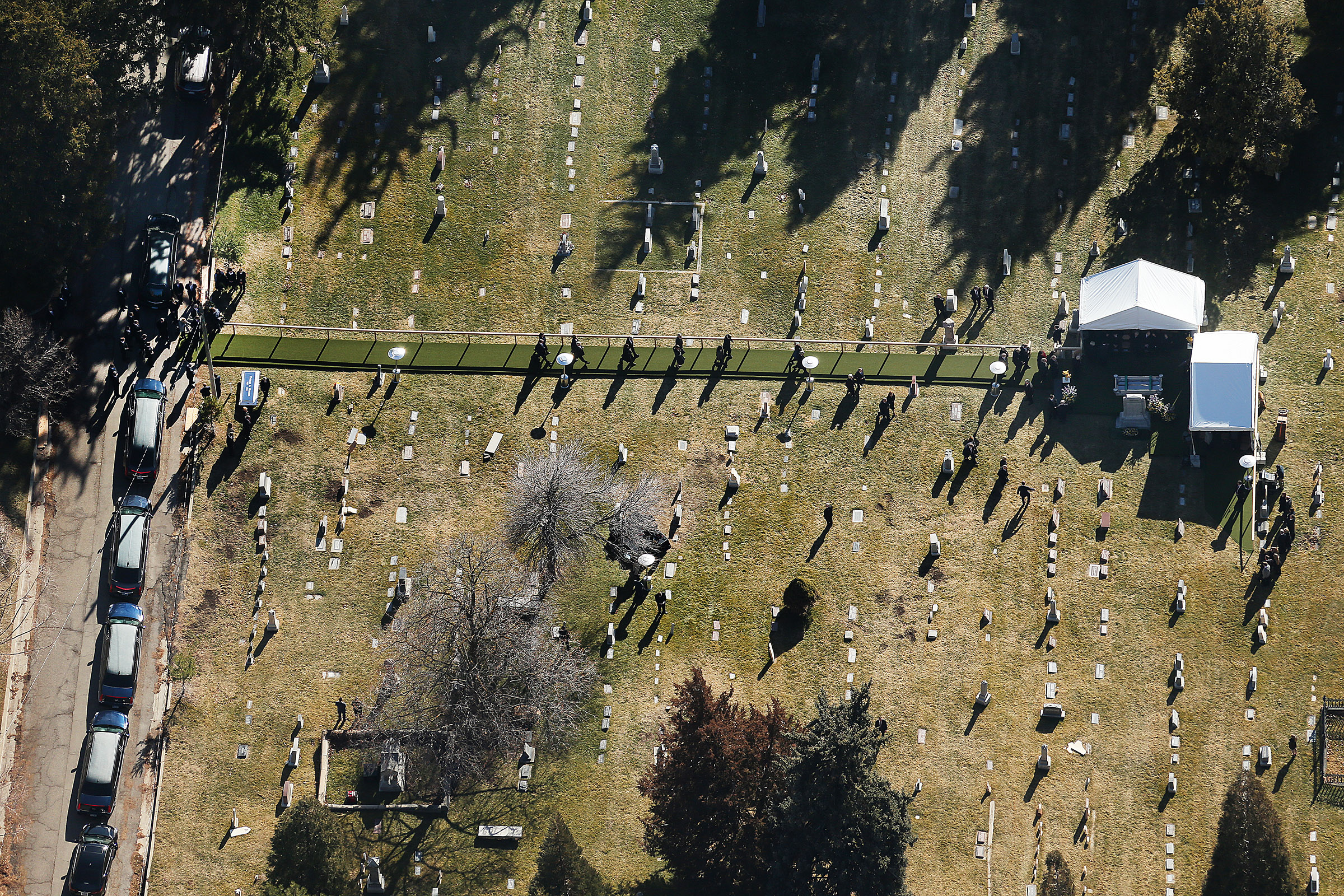 Family members and members of the Church's Quorum of the Twelve Apostles gather for graveside services for President Thomas S. Monson at the Salt Lake City cemetery on Friday, Jan. 12, 2018.