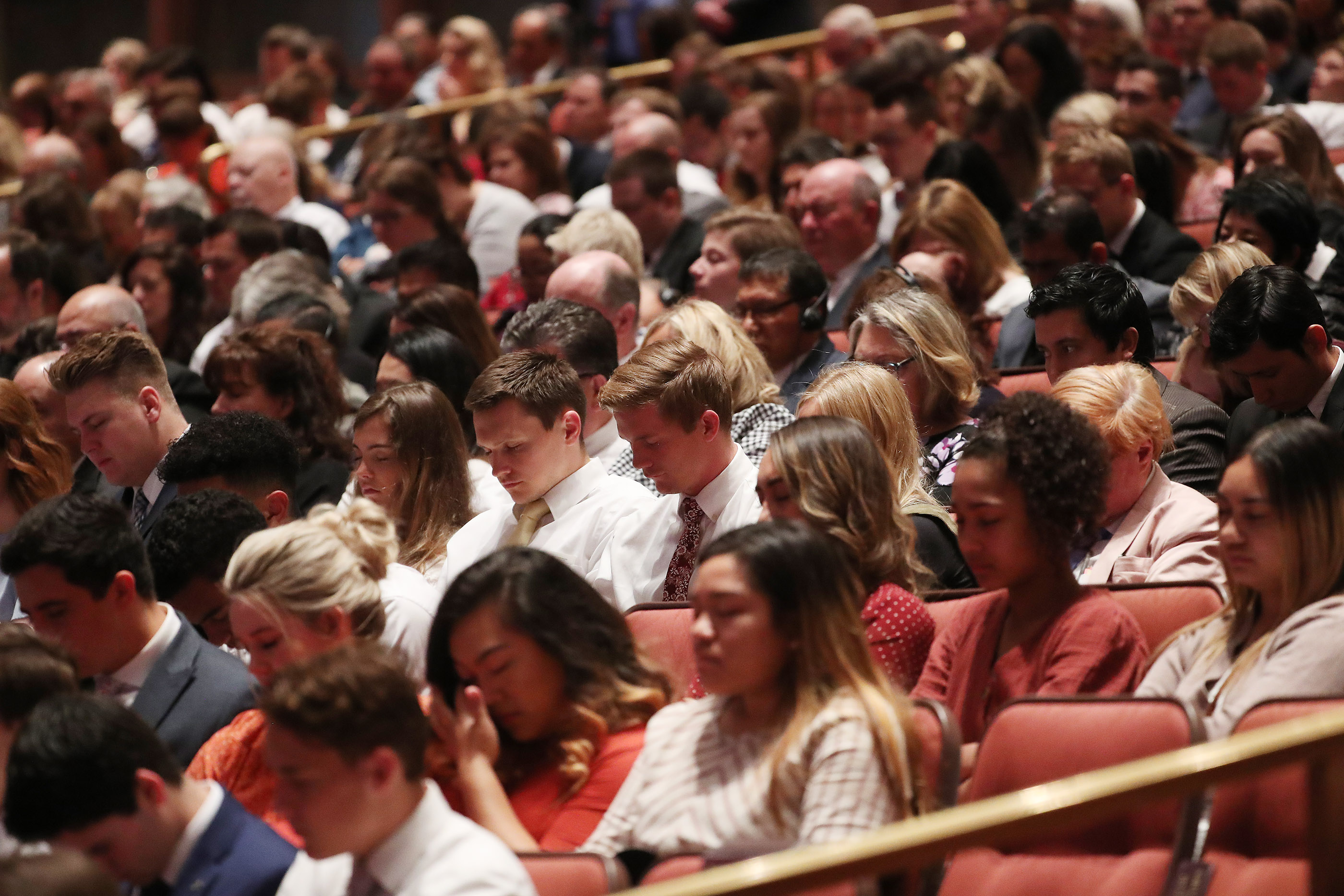 Conferencegoers listen to the opening prayer during the 189th Annual General Conference of The Church of Jesus Christ of Latter-day Saints in Salt Lake City on Saturday, April 6, 2019.
