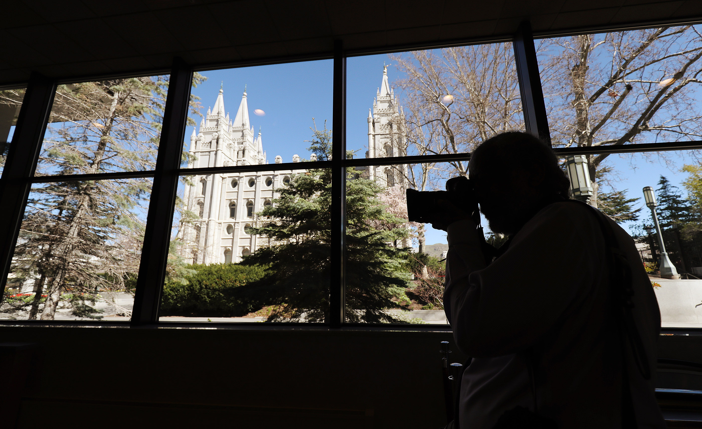 A photographer shoots a photo in the South Visitors' Center on Temple Square in Salt Lake City on Friday, April 19, 2019. Leadership of The Church of Jesus Christ or Latter-day Saints announced renovation plans for the Salt Lake Temple and changes to the temple grounds and Temple Square, including the visitors center.