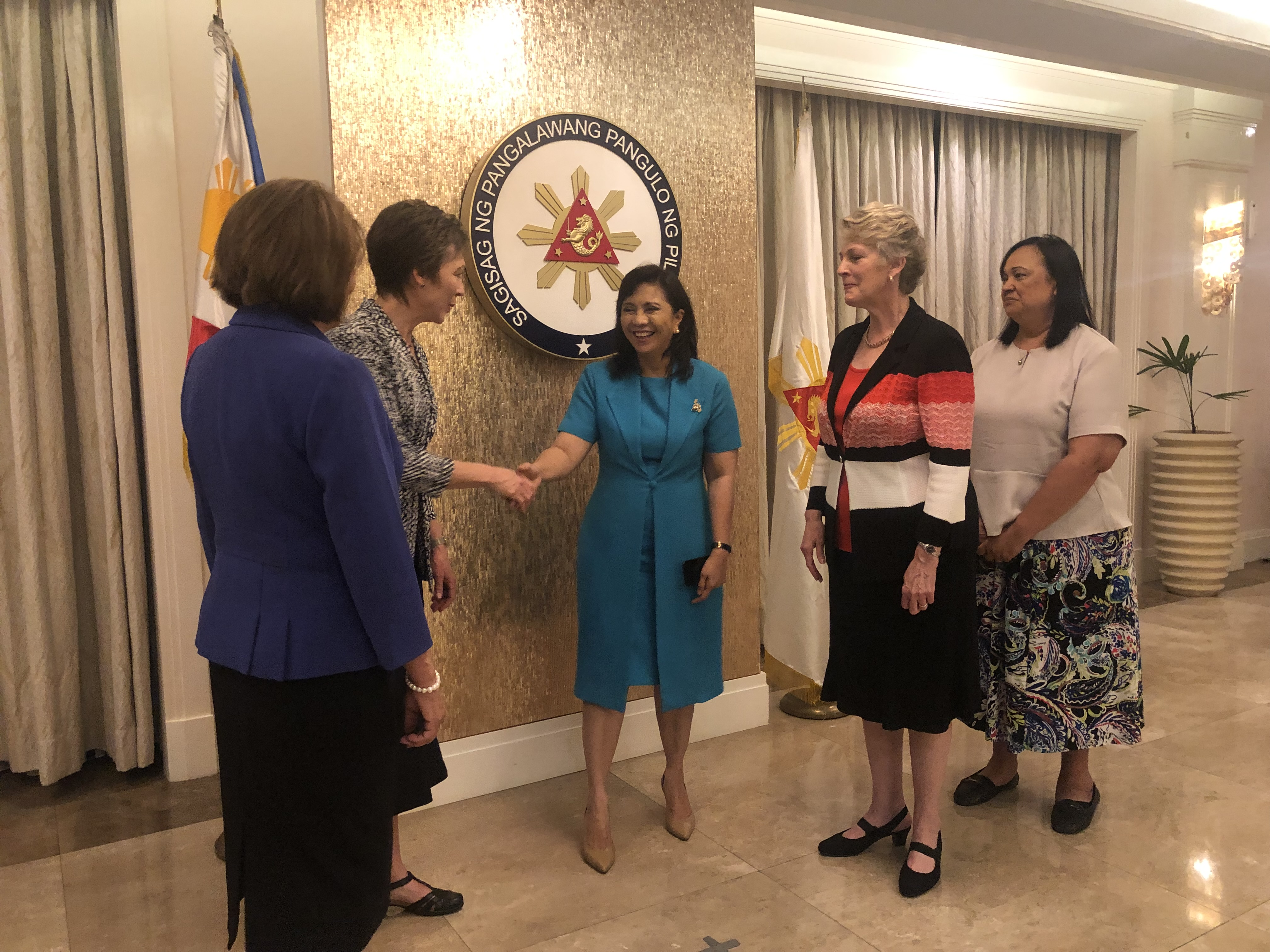 Filipino Vice President Leni Robredo shakes hands with Lynette Cook after meeting with her and Cindy Schmutz, Ruth Renlund and Anita Wakolo in the Philippines.