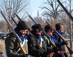 Elder Rawlinson (FAR LEFT) marches with Nauvoo Legion reenactors. Temple in background.