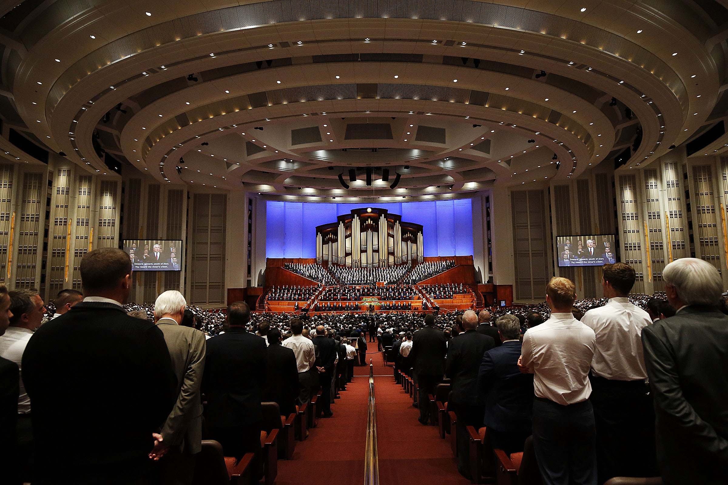 The congregation joins in singing with an Aaronic Priesthood choir from stakes in Layton, Utah, during the priesthood session of the 189th Annual General Conference of The Church of Jesus Christ of Latter-day Saints in the Conference Center in Salt Lake City on Saturday, April 6, 2019.