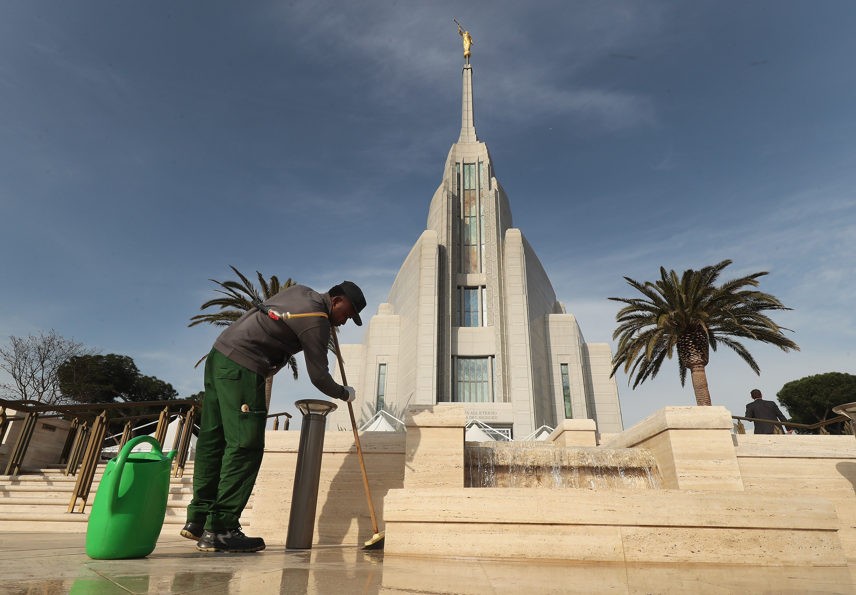 Rhenald Idubor cleans the fountain at the Rome Italy Temple of The Church of Jesus Christ of Latter-day Saints on Friday, March 8, 2019 in preparation for the temple's upcoming dedication