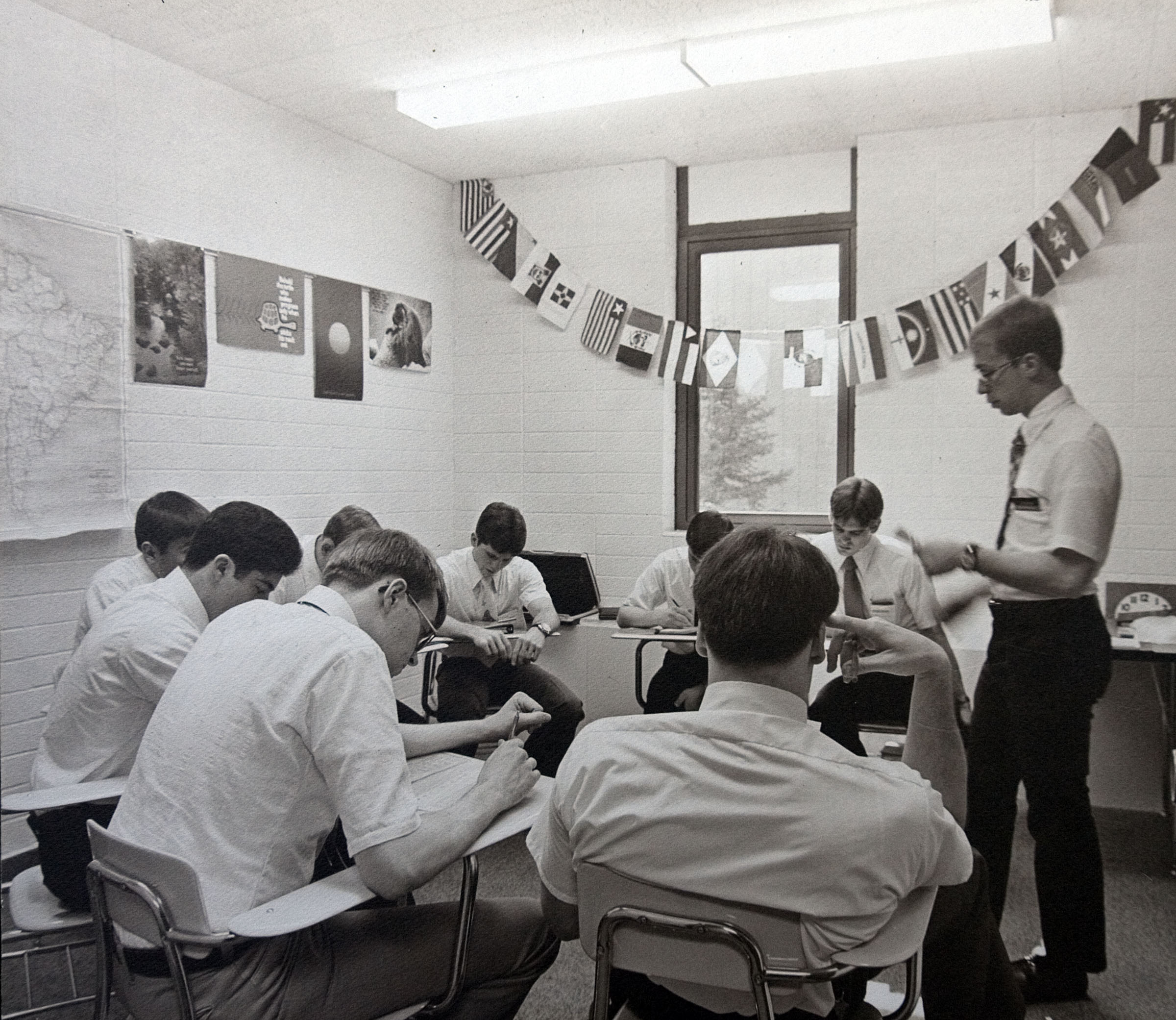 """Missionaries spend many classroom hours each day learning foreign language and missionary discussions, practicing teaching skills, studying scriptures, and developing deeper understanding of gospel doctrines and principles."" — This is the caption information found on the frame plaque accompany this photo, one nearly dozen historical photos showing the development of the Language Training Mission and Missionary Training Center facilities in Provo since the 1960s."