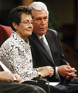 President Dieter F. Uchtdorf and Sister Harriet Uchtdorf during a devotional for workers at the Bountiful Utah Temple, inside the Tabernacle on Temple Square.