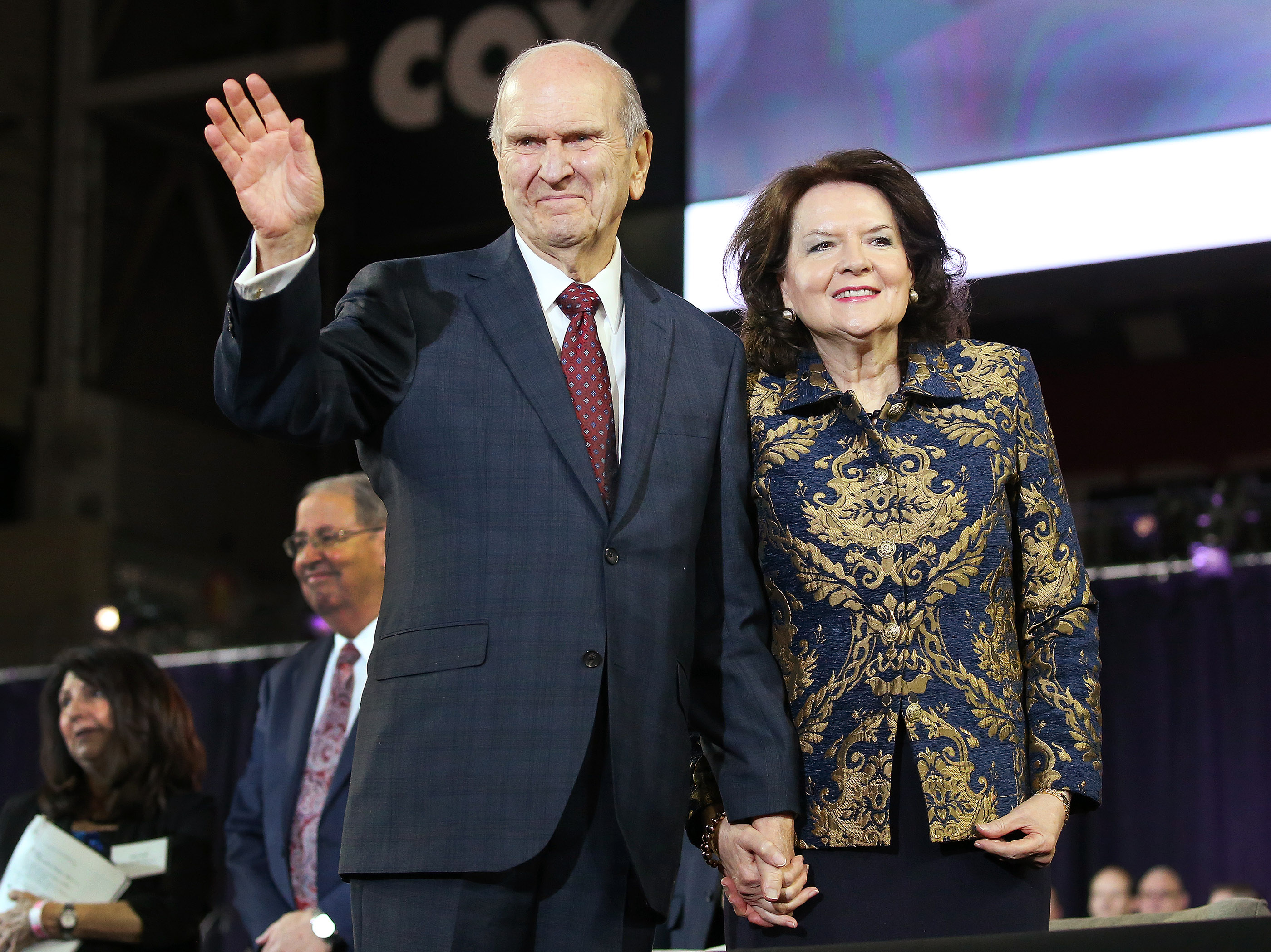 President Russell M. Nelson of The Church of Jesus Christ of Latter-day Saints waves to attendees with his wife Wendy after a devotional at the State Farm Stadium in Phoenix on Sunday, Feb. 10, 2019.